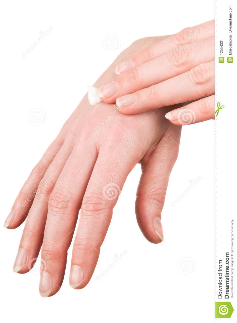Woman putting cream on her hands