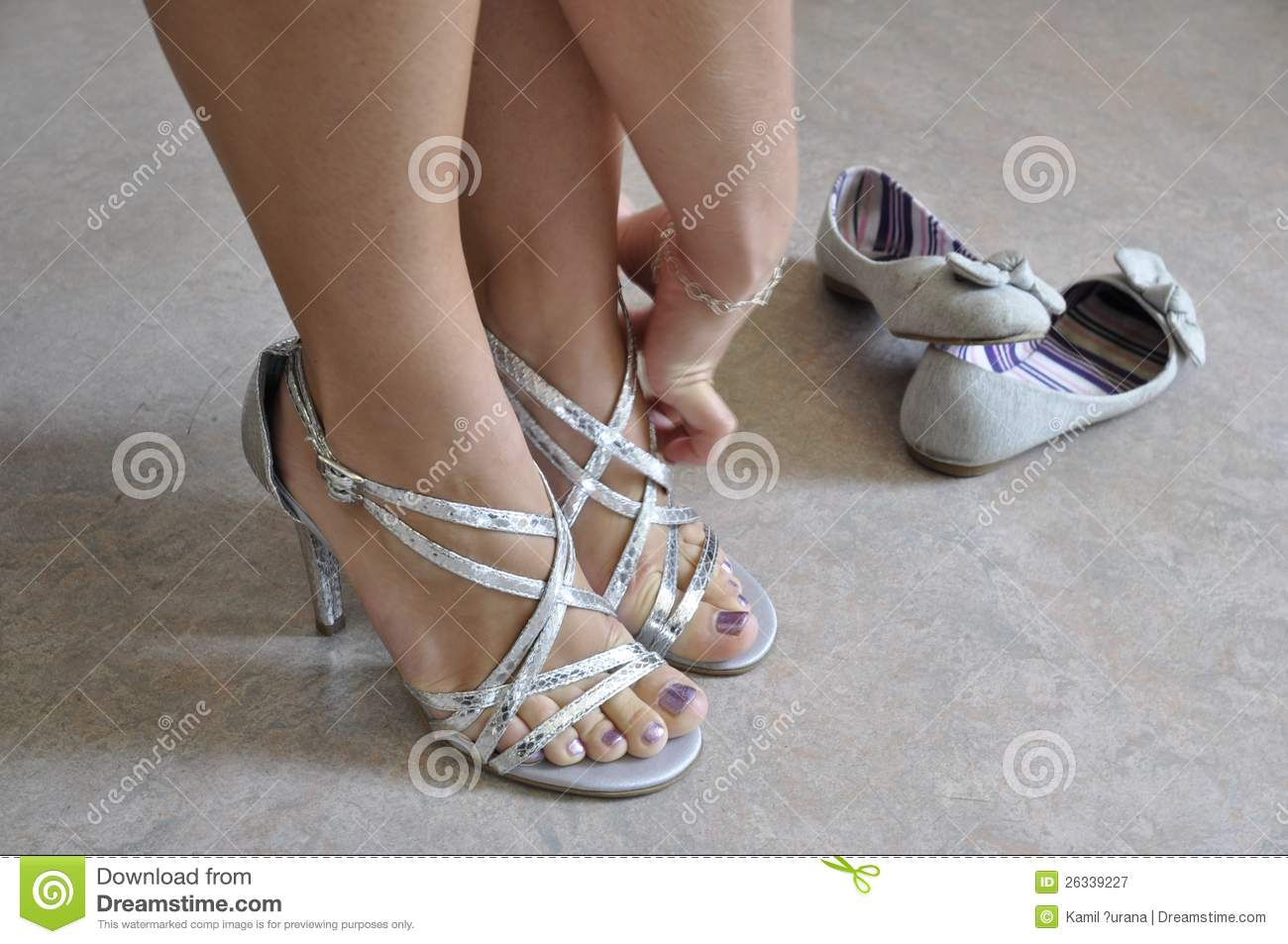 Woman Putting On Dressy Shoes Royalty Free Stock ...