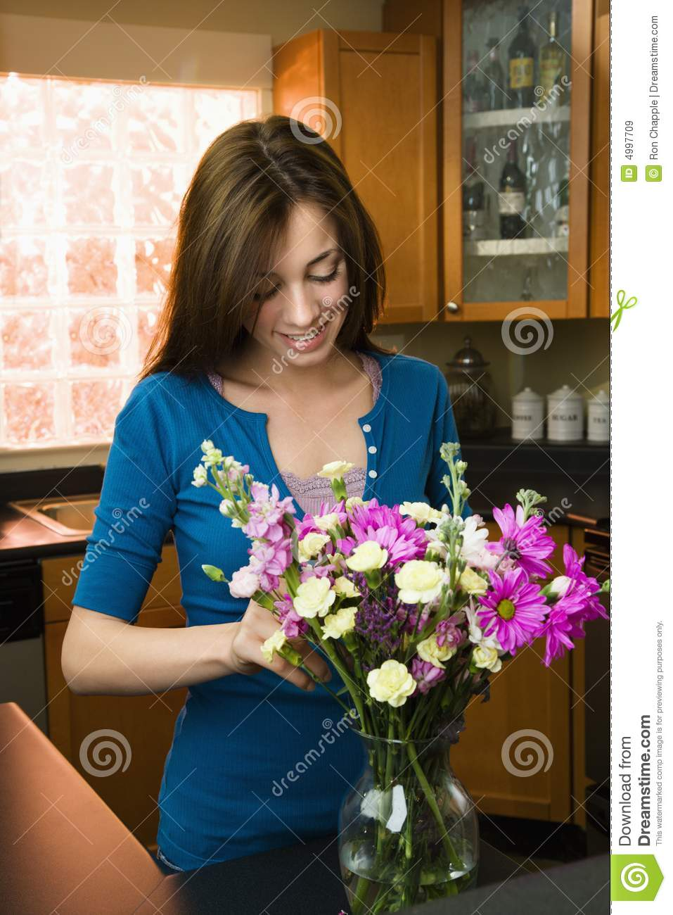Woman putting flowers in vase stock image image of 080403d0040 woman putting flowers in vase reviewsmspy