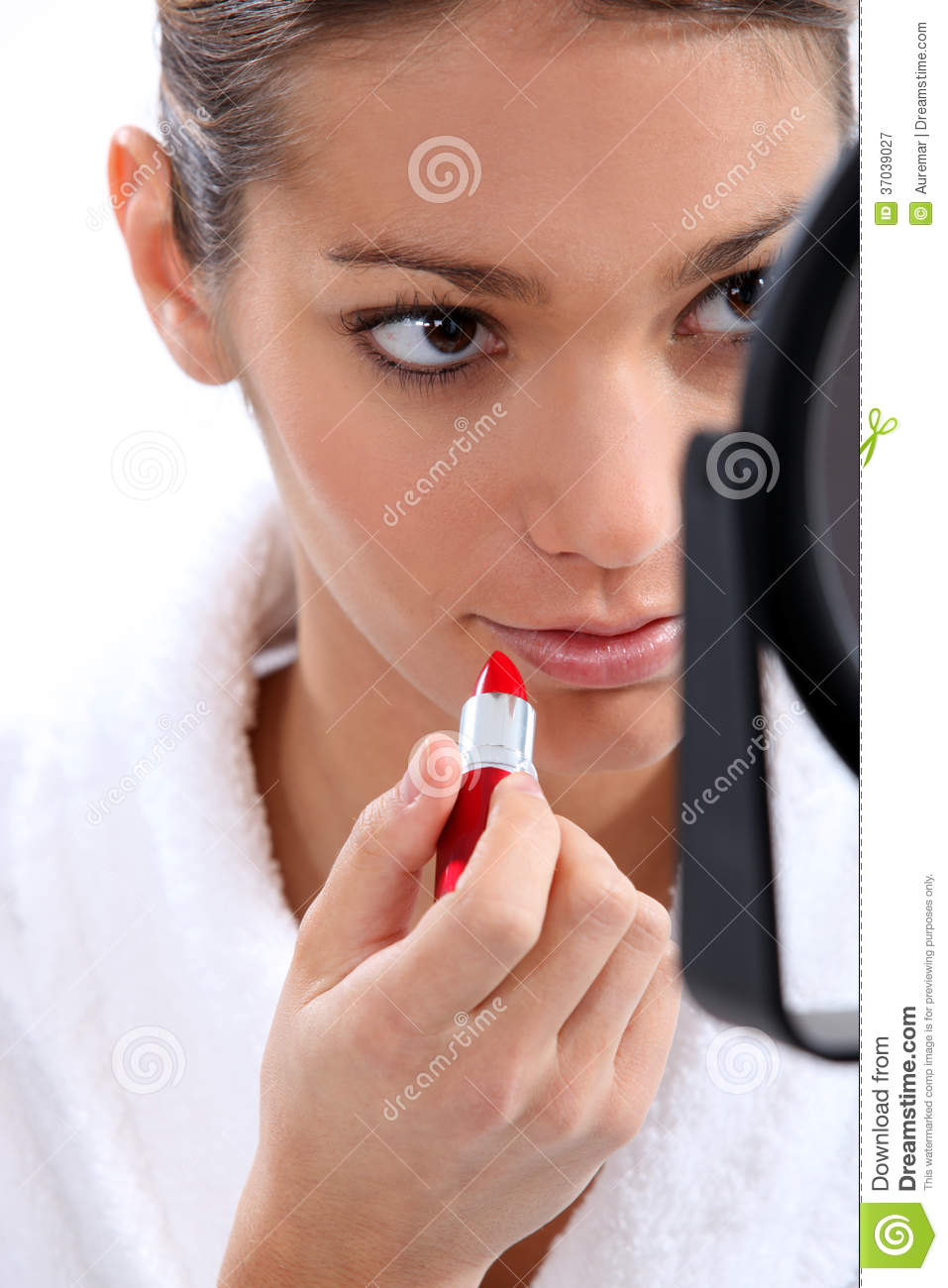 Woman Putting On Lipstick Stock Image. Image Of Implement