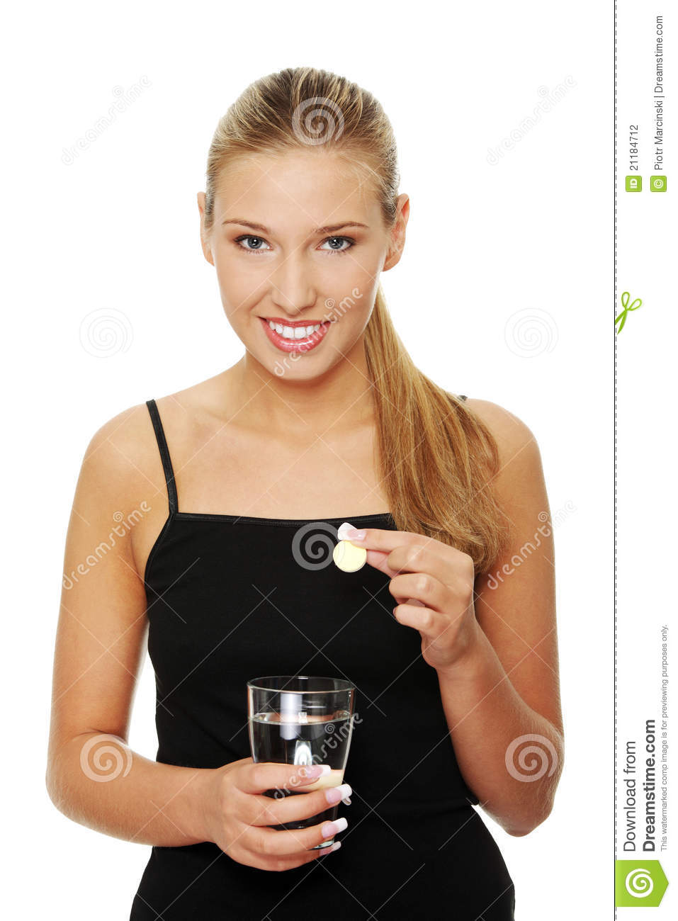 Woman putting pill into glass full of water