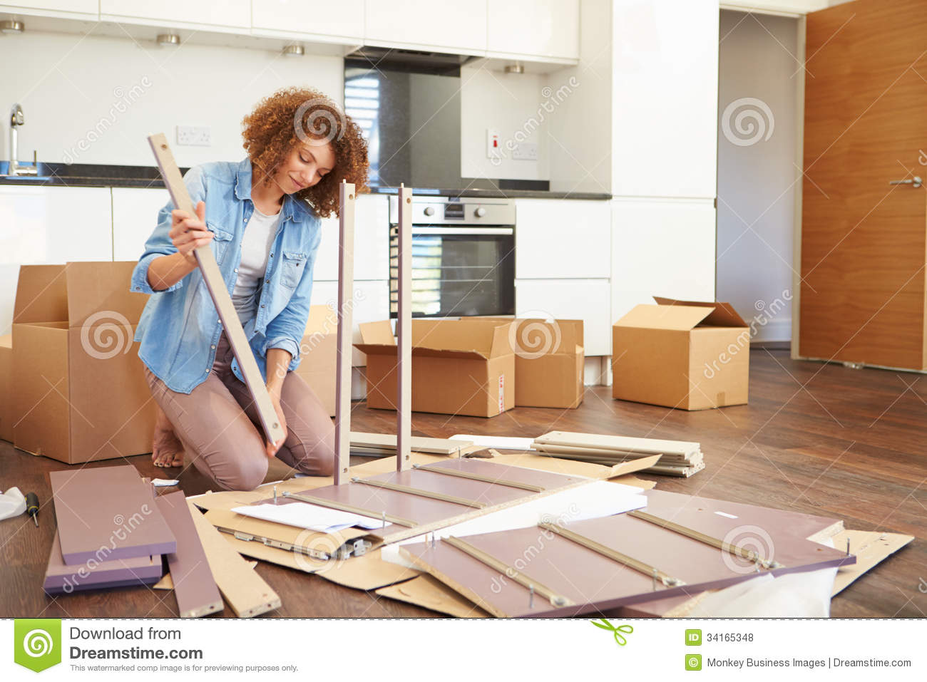 Awesome Woman Putting Together Self Assembly Furniture In New Home Royalty Free  Stock Photos