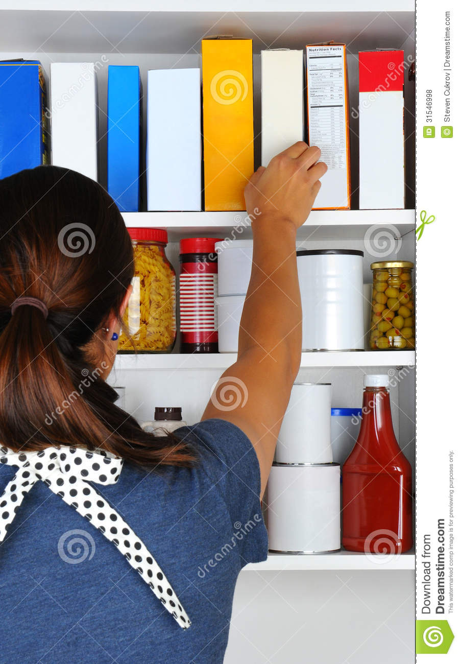 Woman Reaching Into Pantry Stock Photo Image Of Cereal