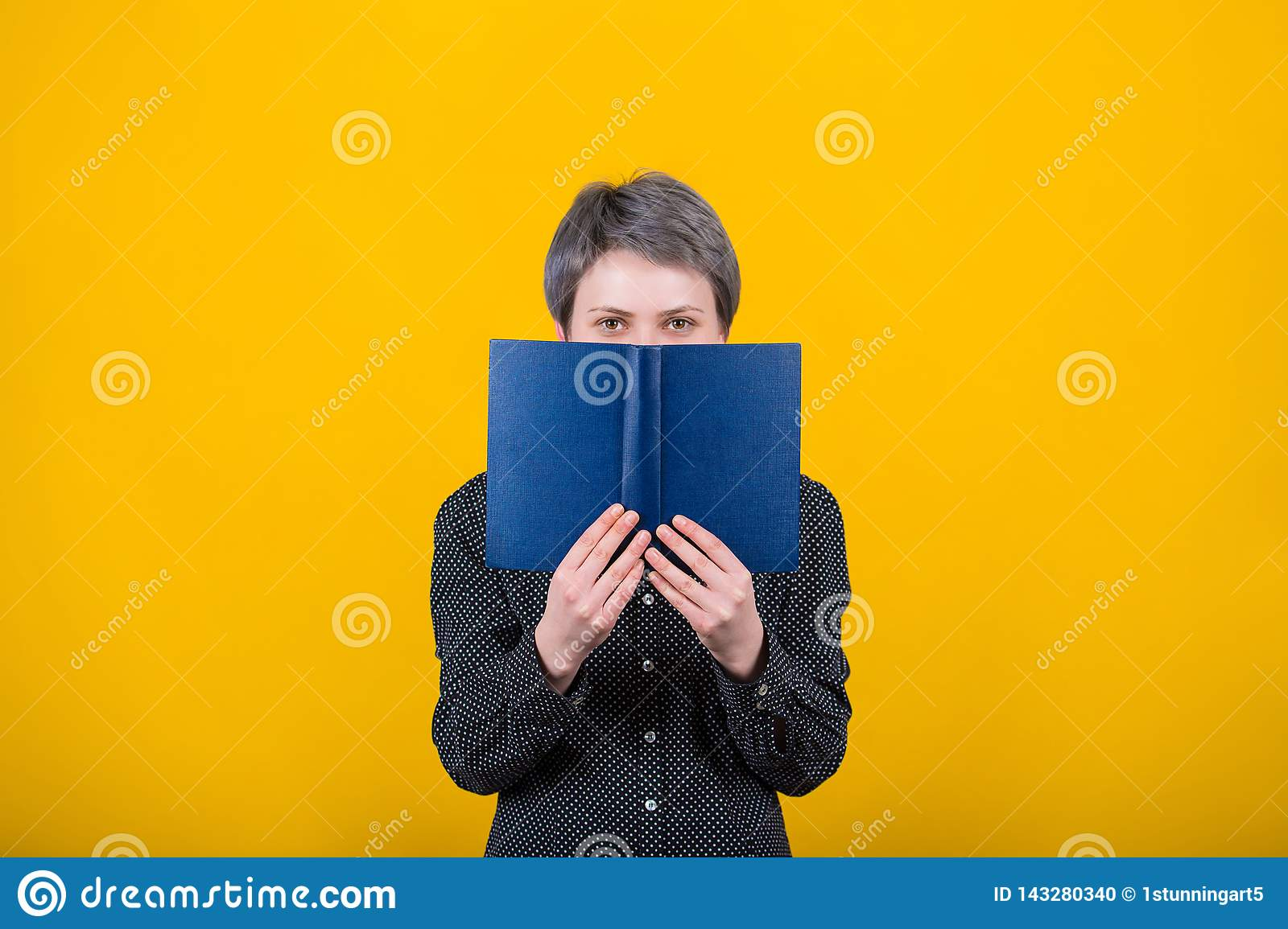 Woman reader holding textbook