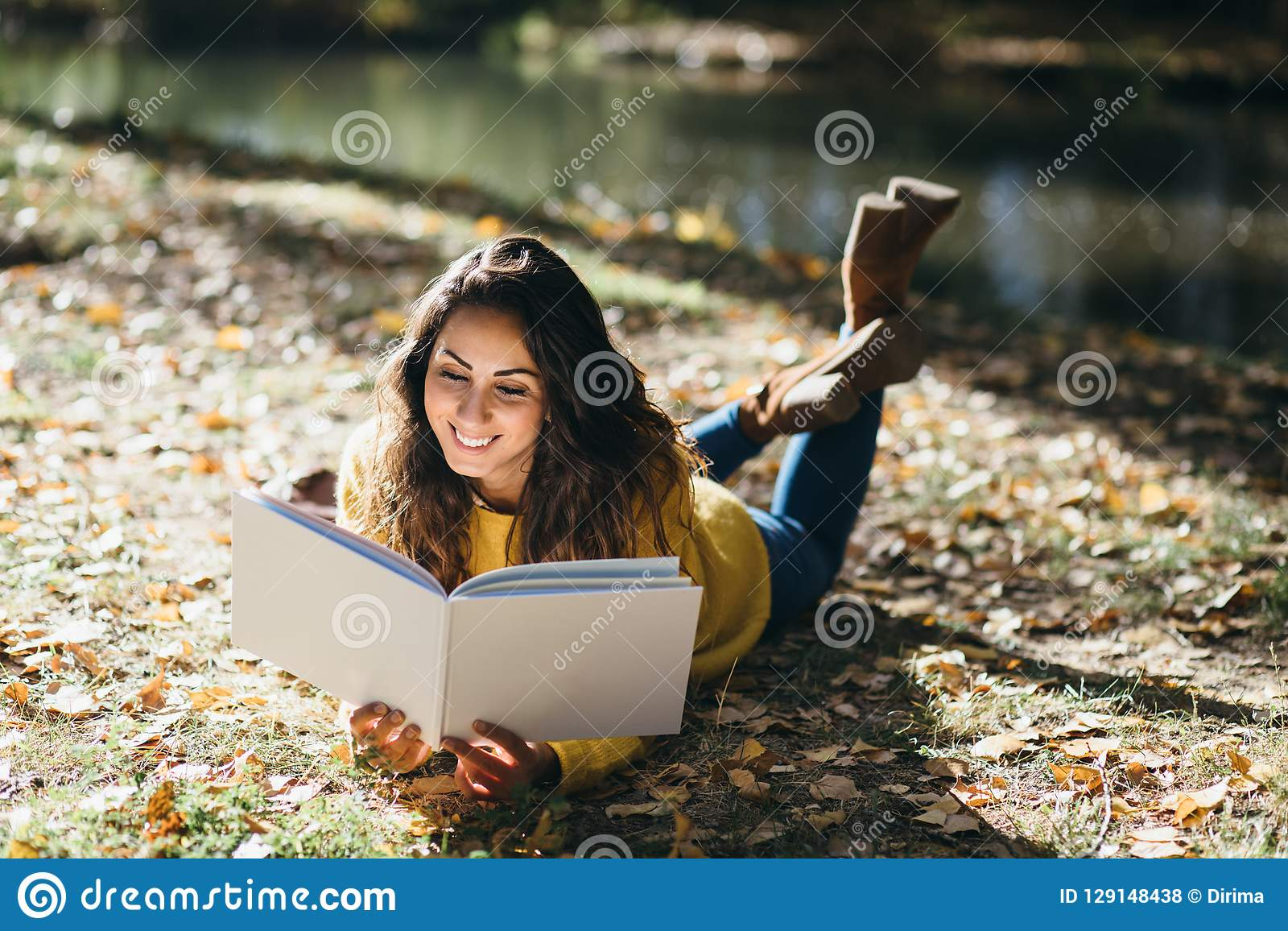 Woman reading in autumn outdoor
