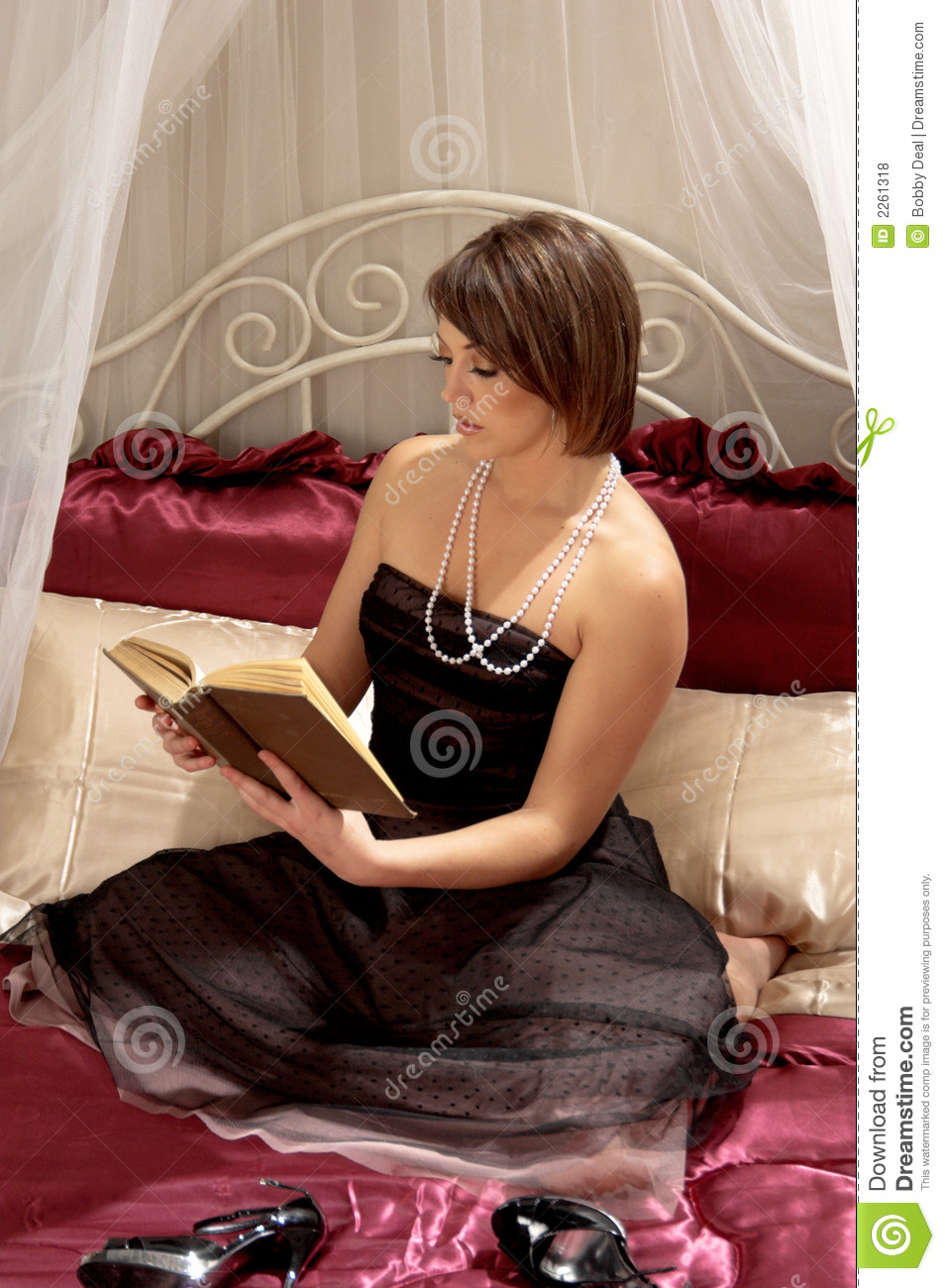 Woman Reading Book On Bed Stock Photo Image Of Gown Pearls 2261318