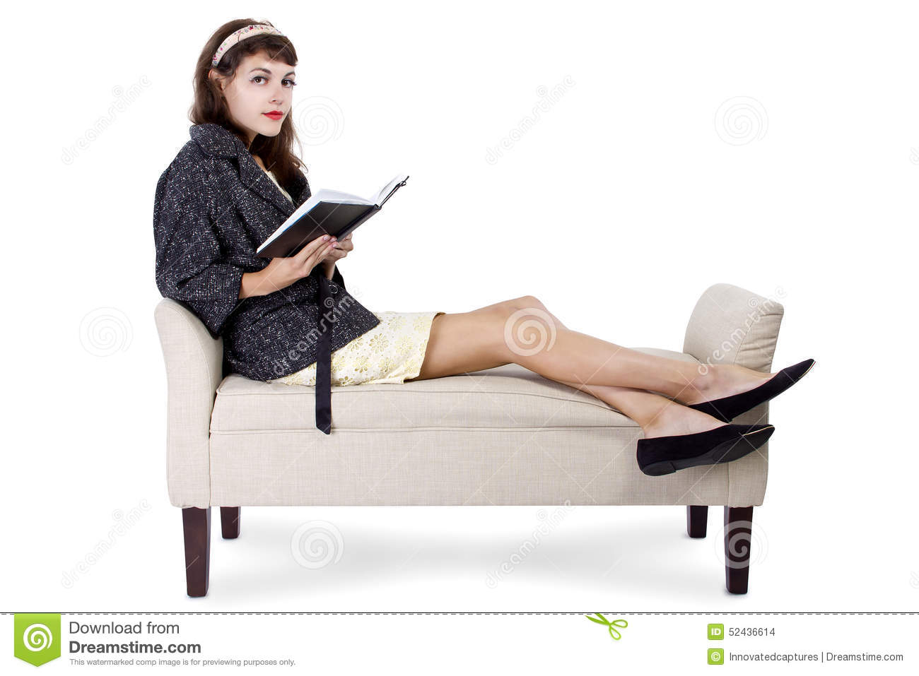 Woman reading a book on a chaise lounge stock photo for Best chaise lounge for reading