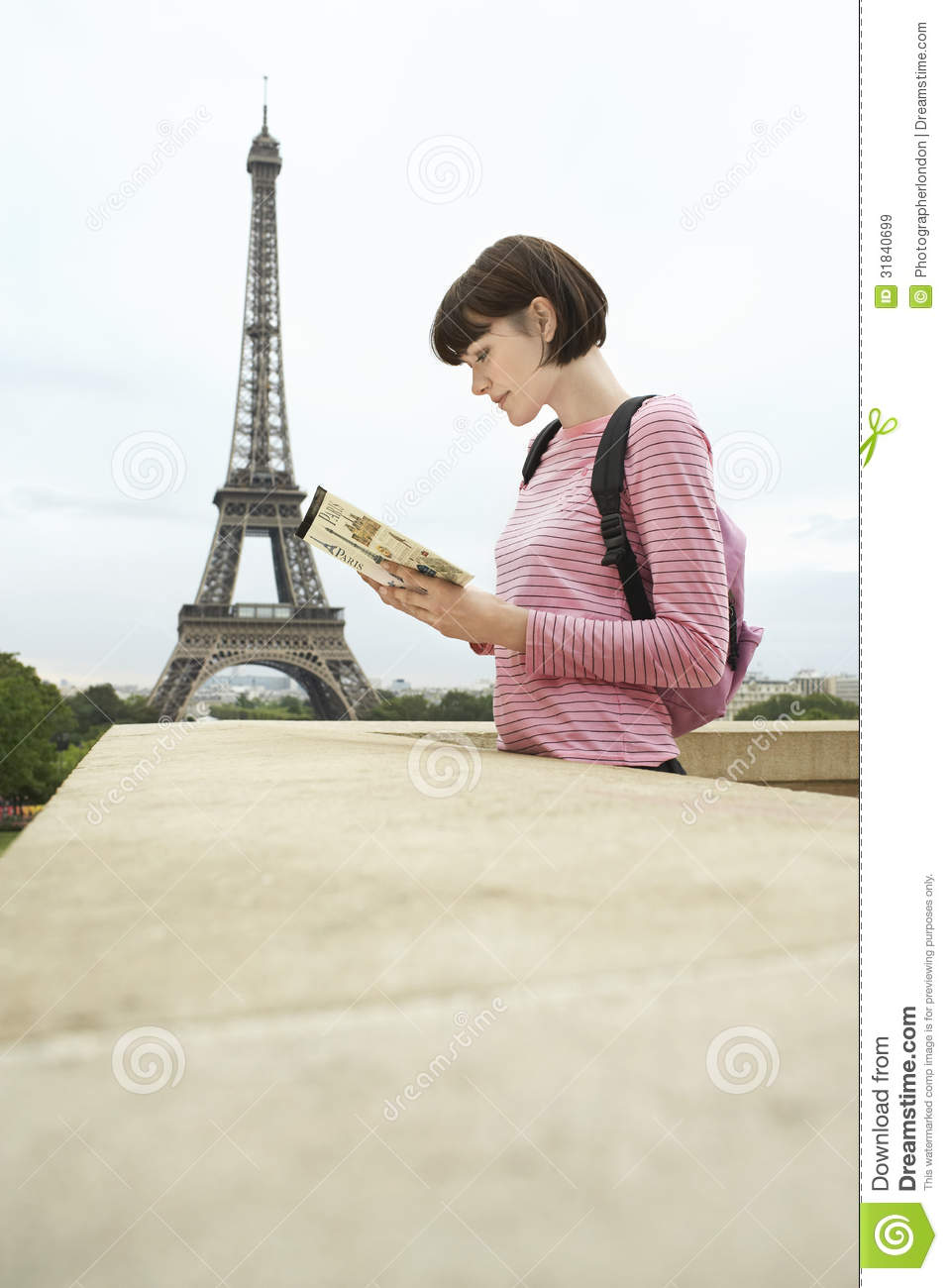 Woman reading book in front of eiffel tower stock image for The balcony book
