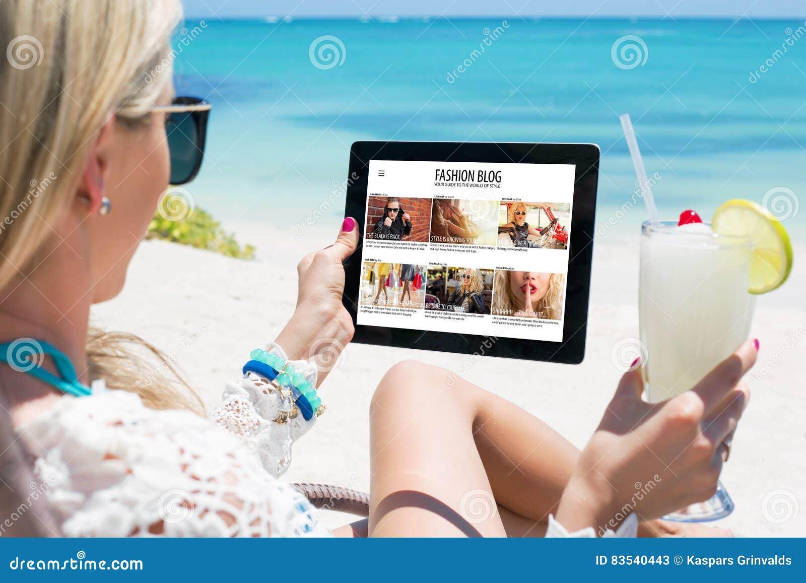 Woman reading fashion blog