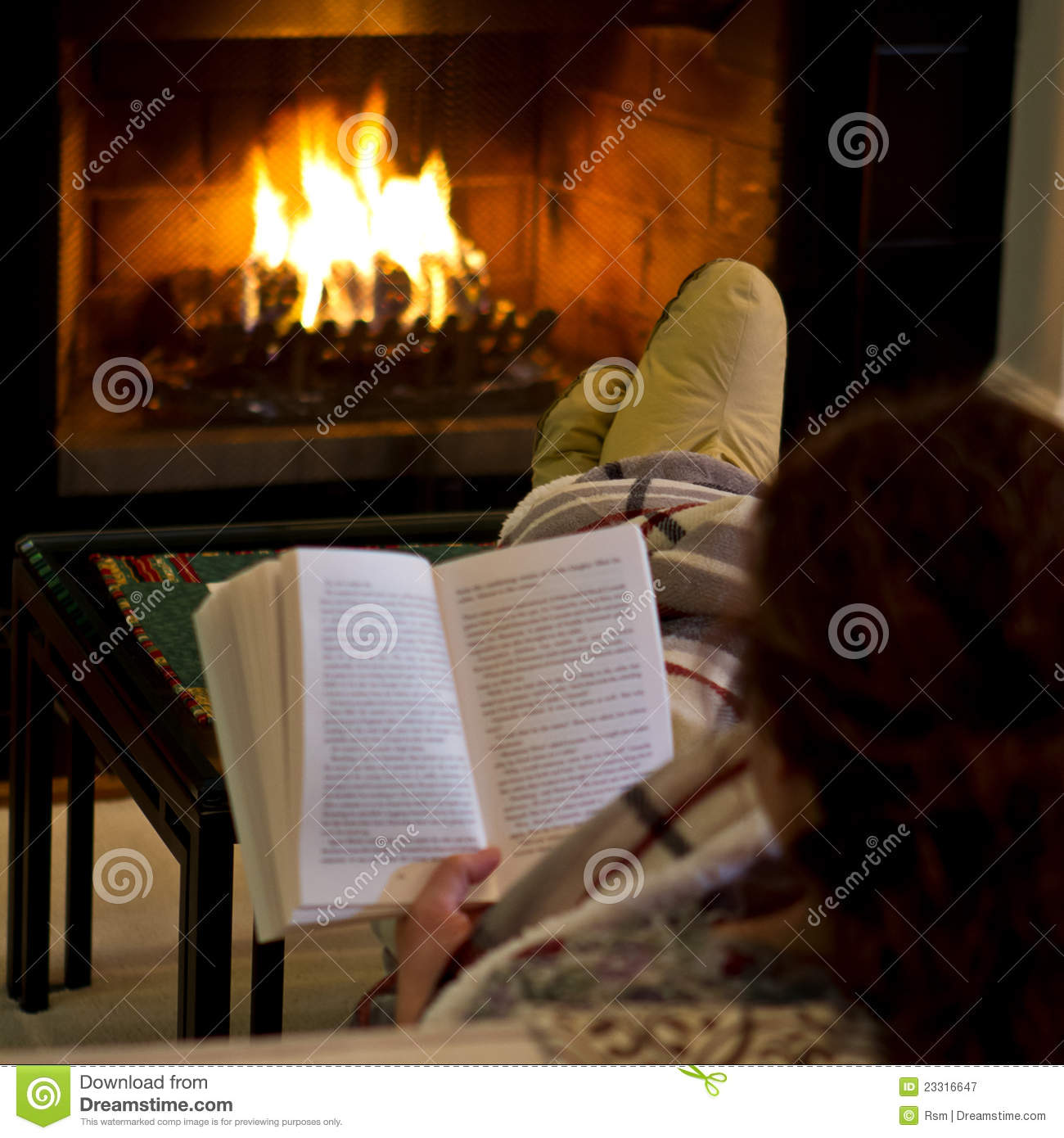 woman reading by fireplace royalty free stock photography image