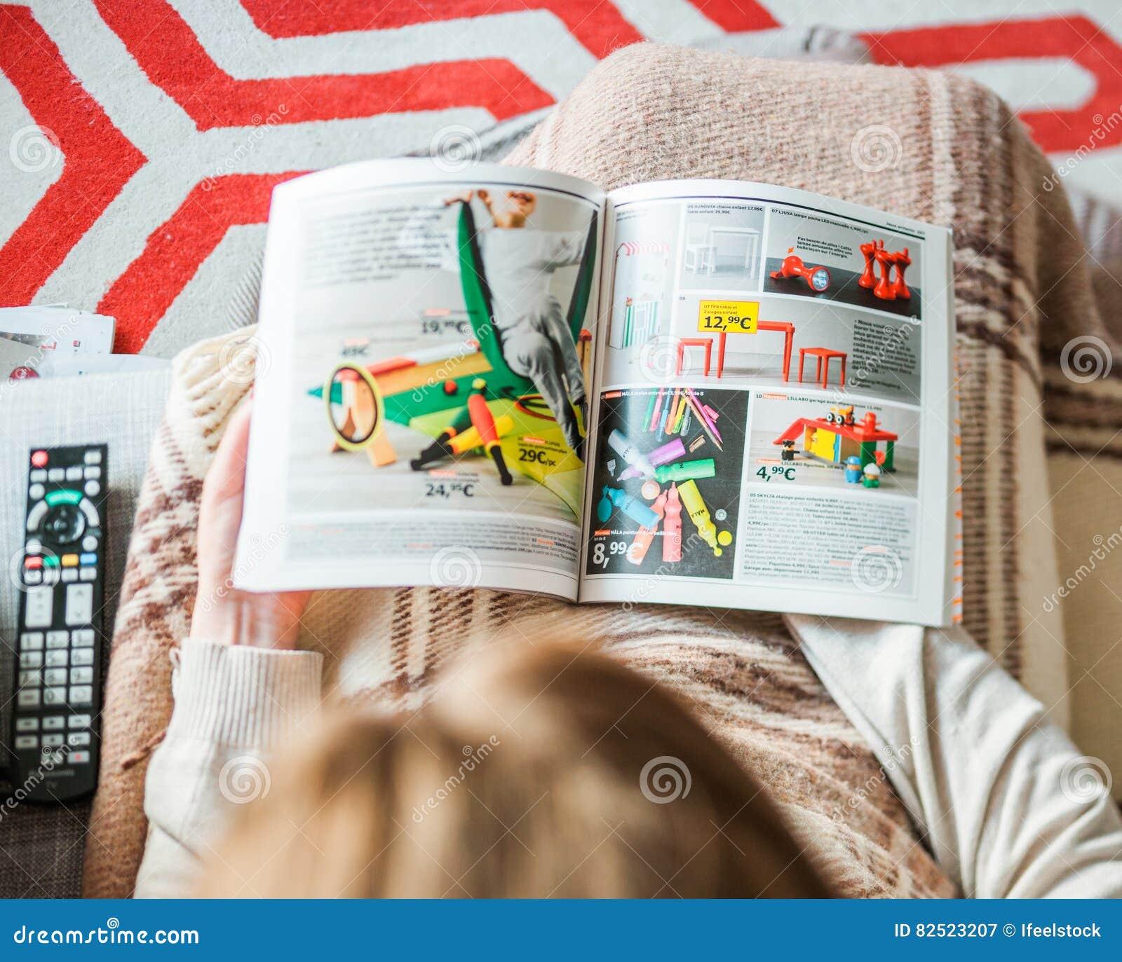 woman reading ikea catalog furnishing house kids furniture editorial photography image 82523207. Black Bedroom Furniture Sets. Home Design Ideas