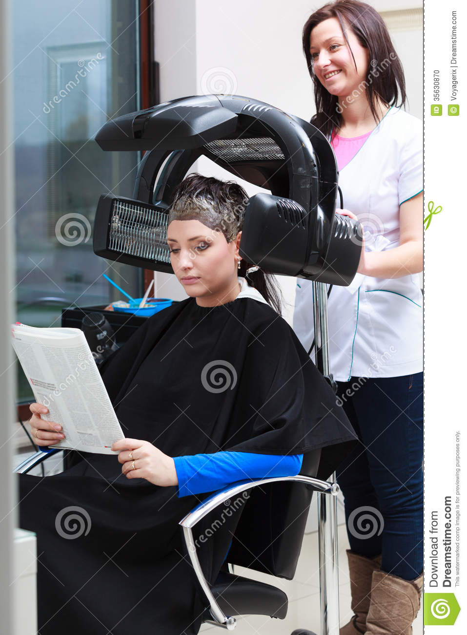 Woman Reading Magazine In Hair Beauty Salon. By Hairdresser. Stock ...