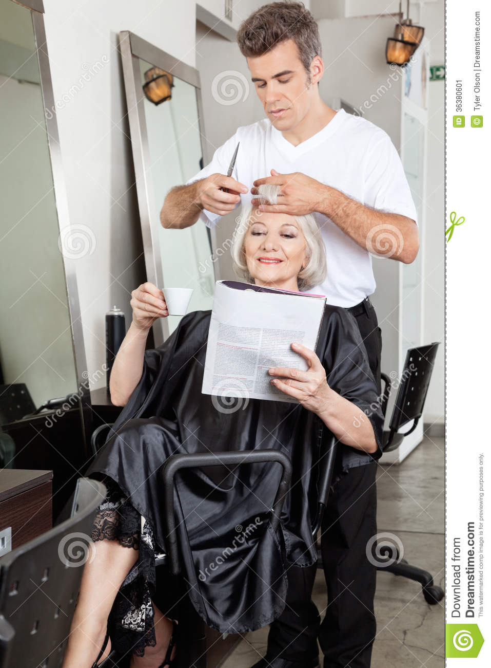 Woman reading magazine while having haircut stock image for Reading beauty salon