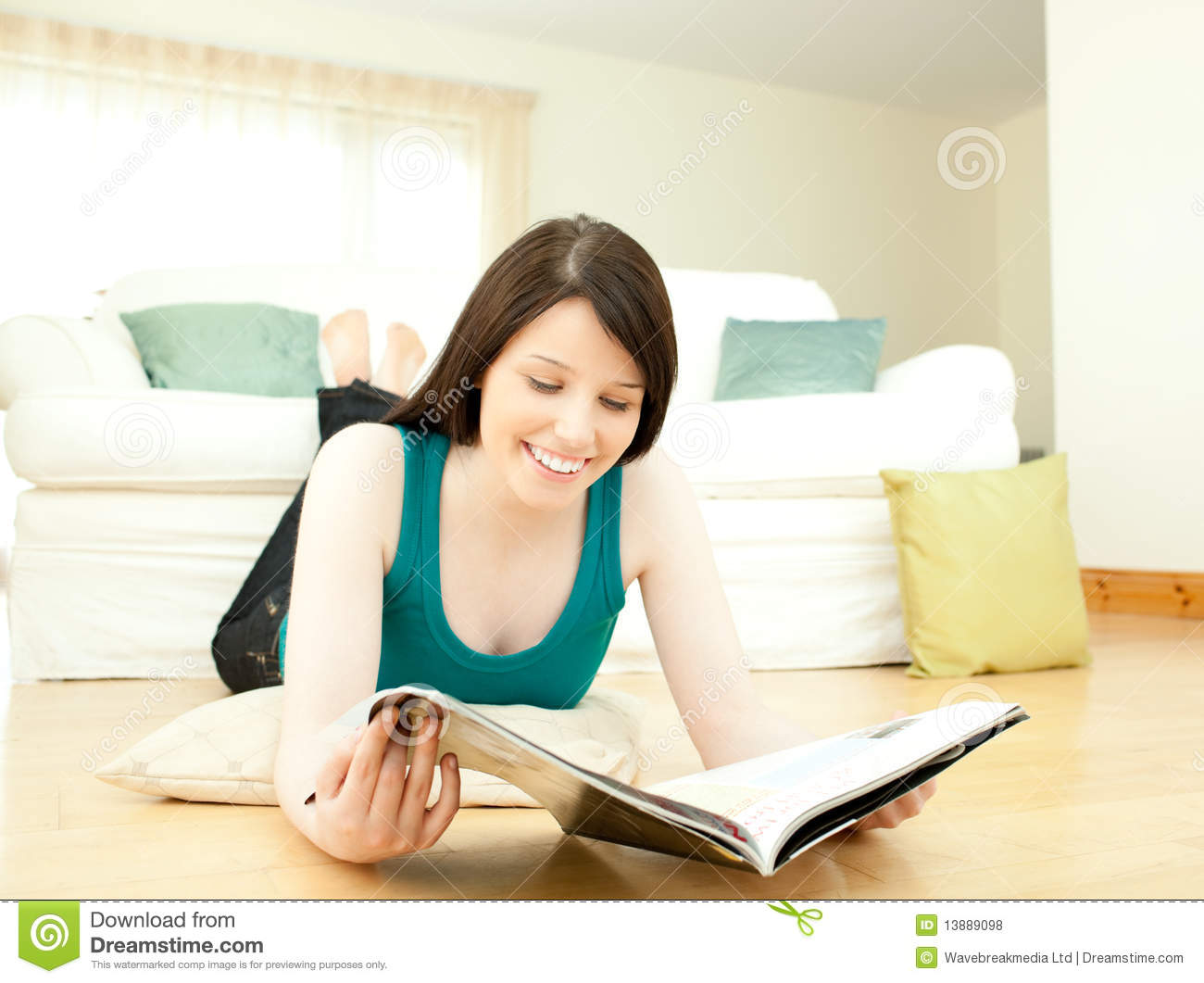 Woman Reading A Magazine Lying Down On The Floor Royalty