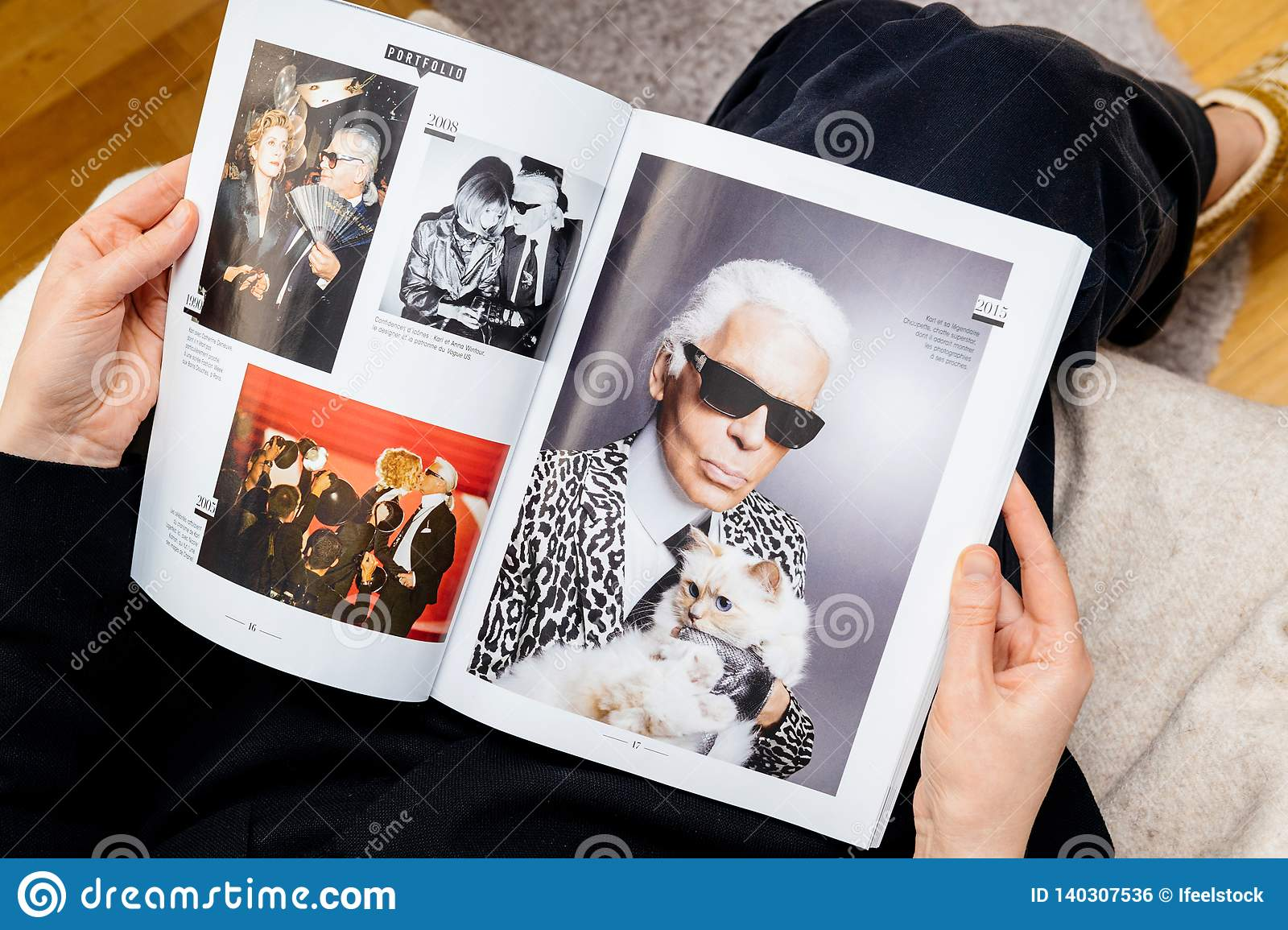 Woman Reading Newsapepr About Karl Lagerfeld Death Photo With