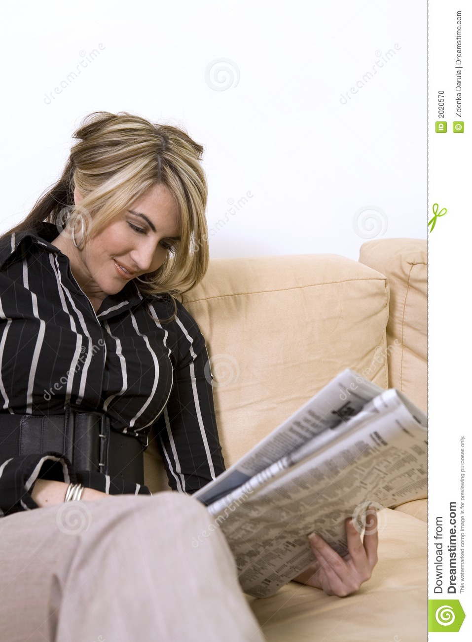 Woman Reading Newspaper Stock Photo - Image: 2020570
