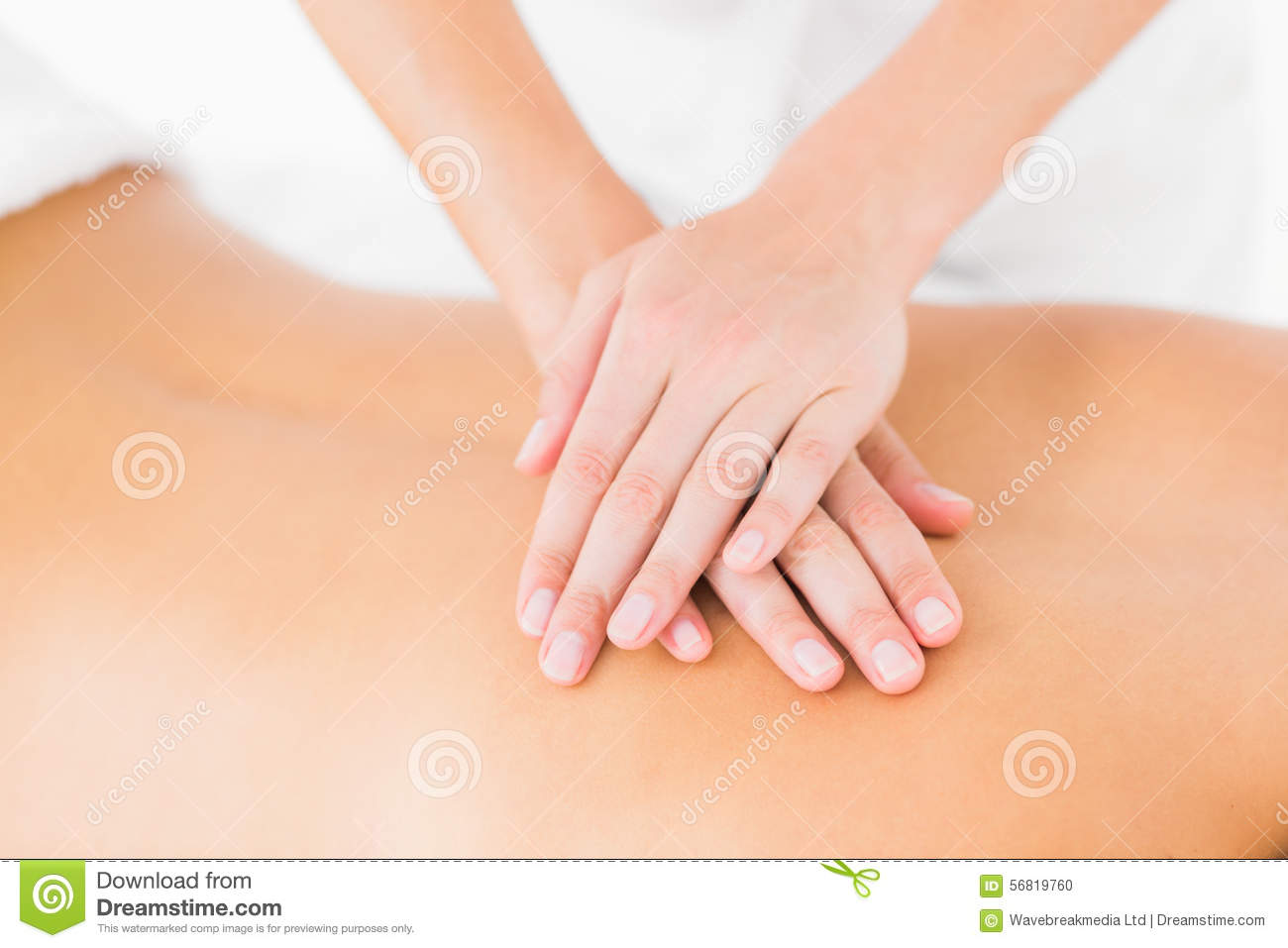 woman receiving back massage at spa center stock photo