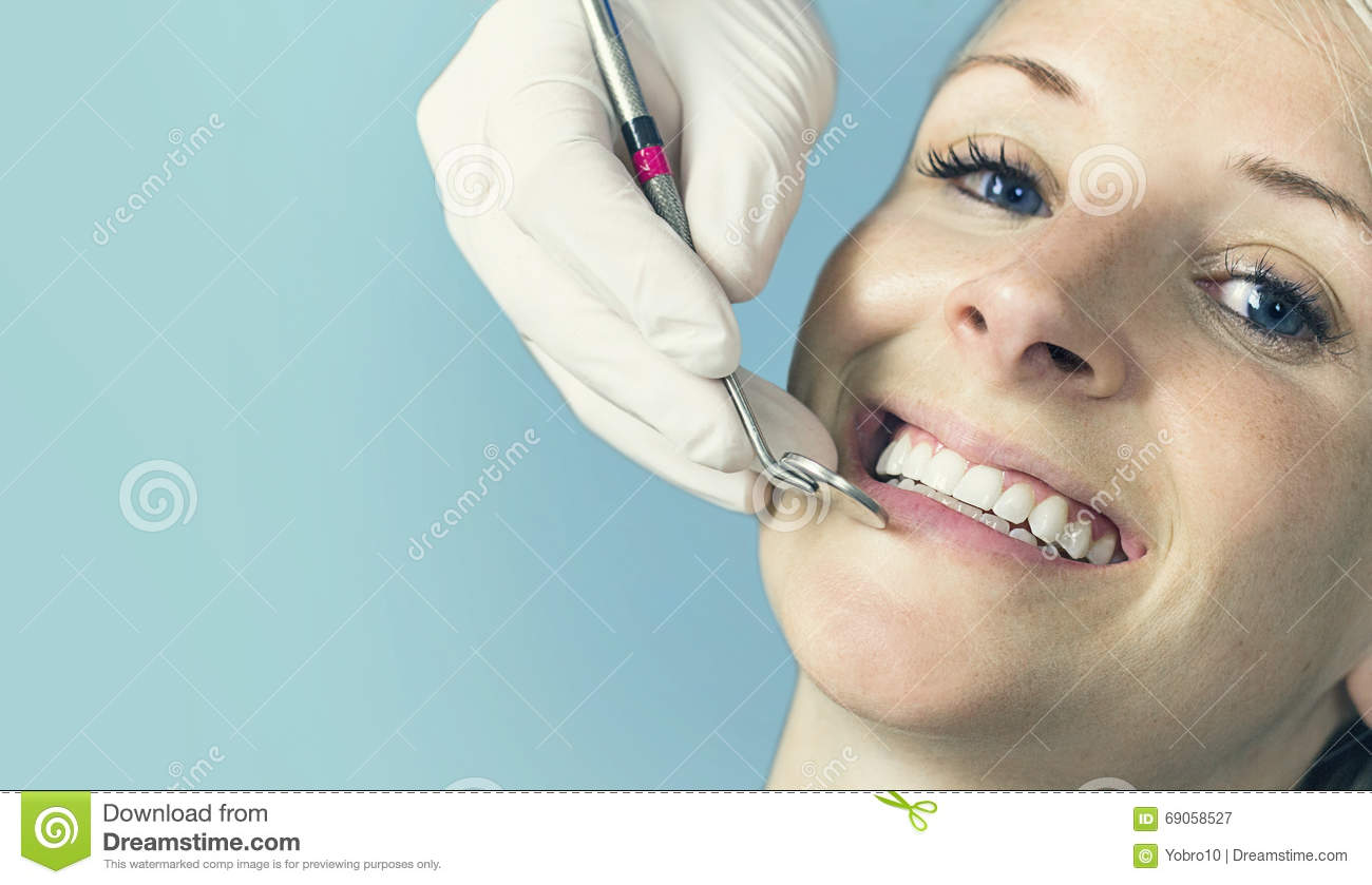 No Credit Check Car Lots >> Woman Receiving A Dental Check Up From Her Dentist Stock ...