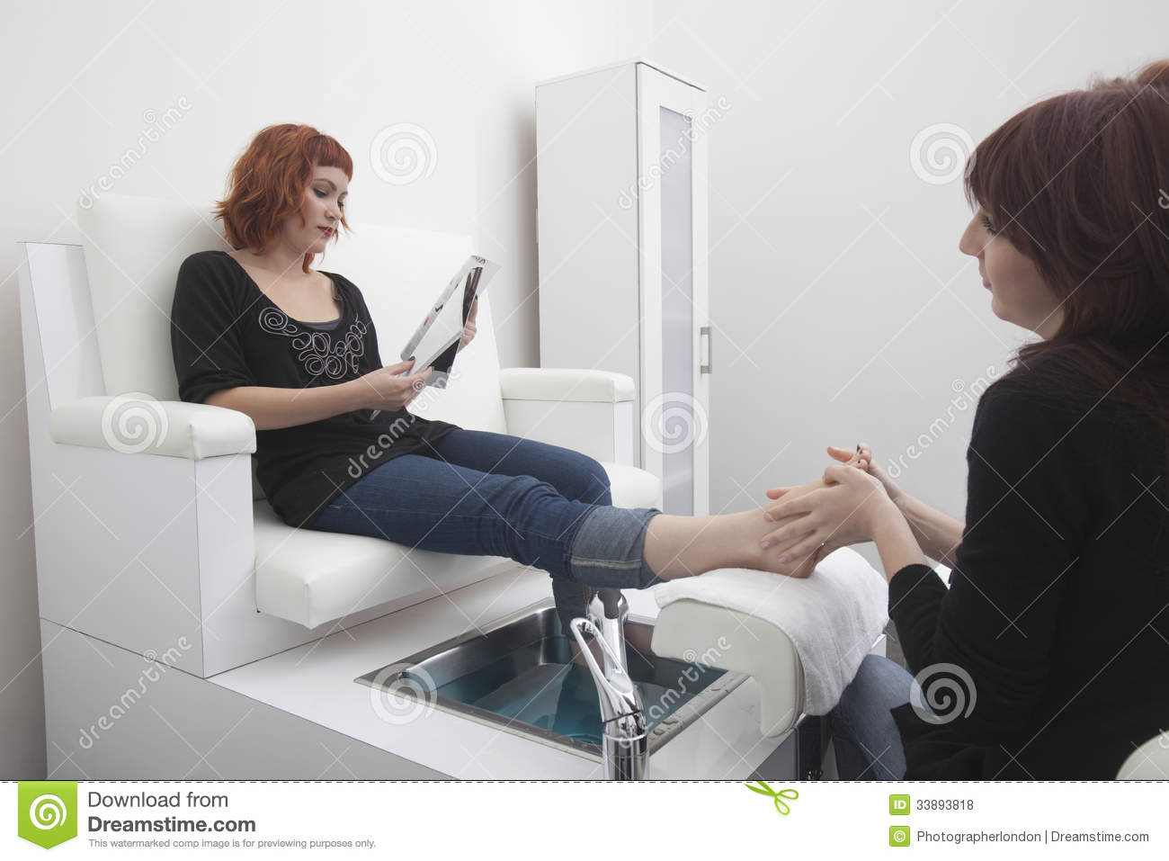 woman receiving pedicure in hairdressing salon stock photo