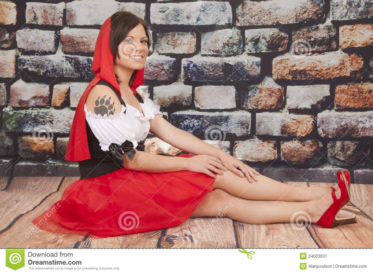 Woman red cape tattoo claw legs out