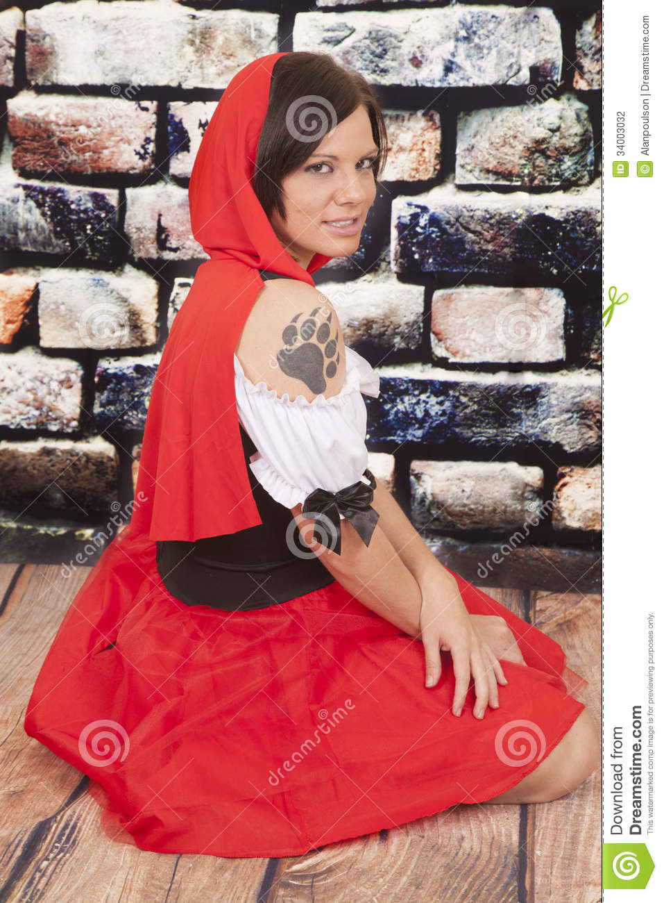 Woman red cape tattoo claw serious