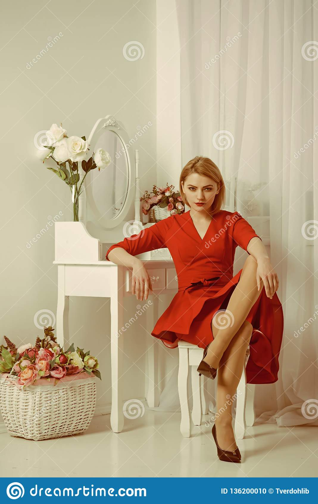 Woman In Red Dress Woman Grooming In Morning At Mirror Bedroom