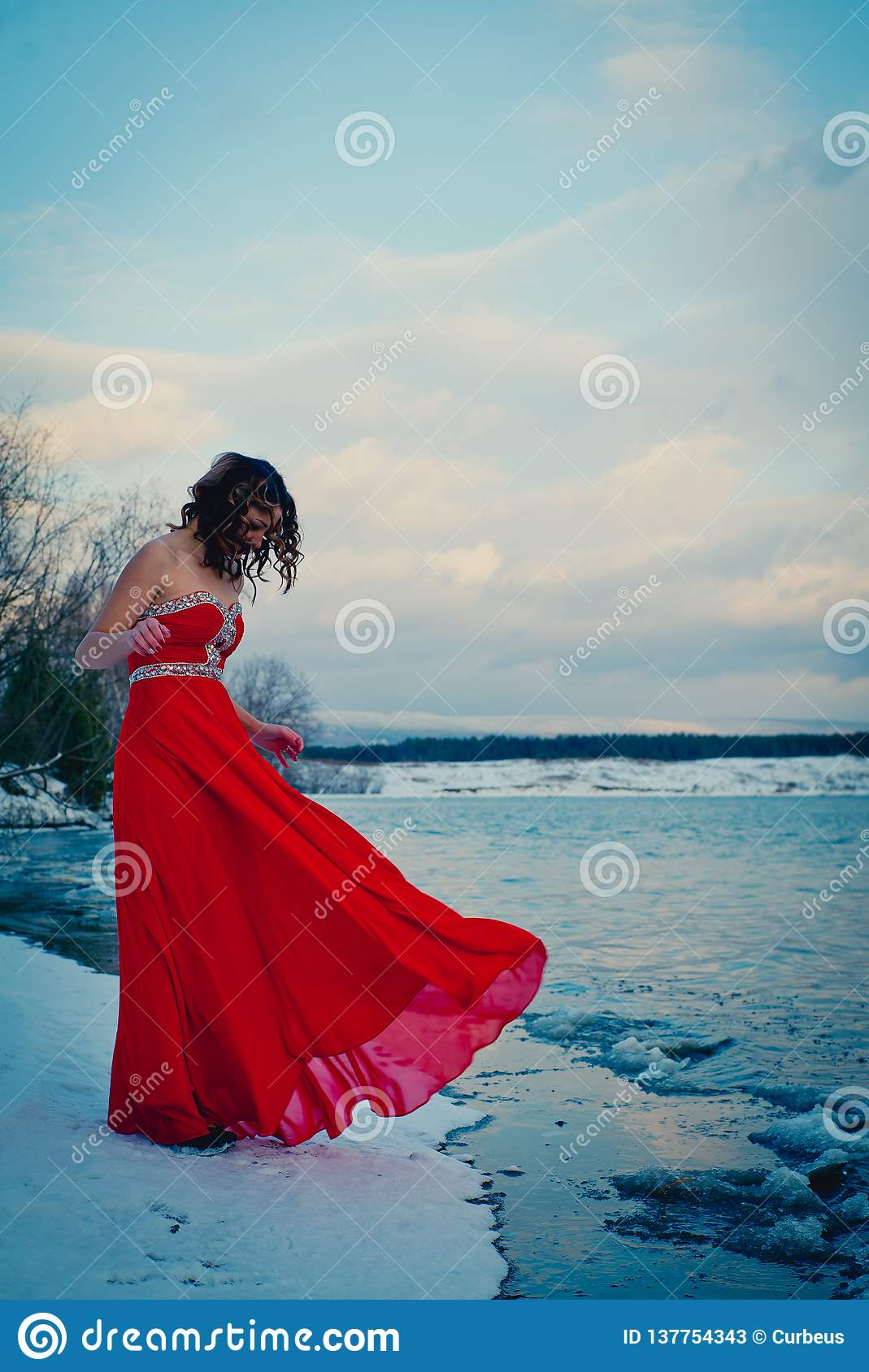Woman in red dress. Siberia, ice water, winter, very cold