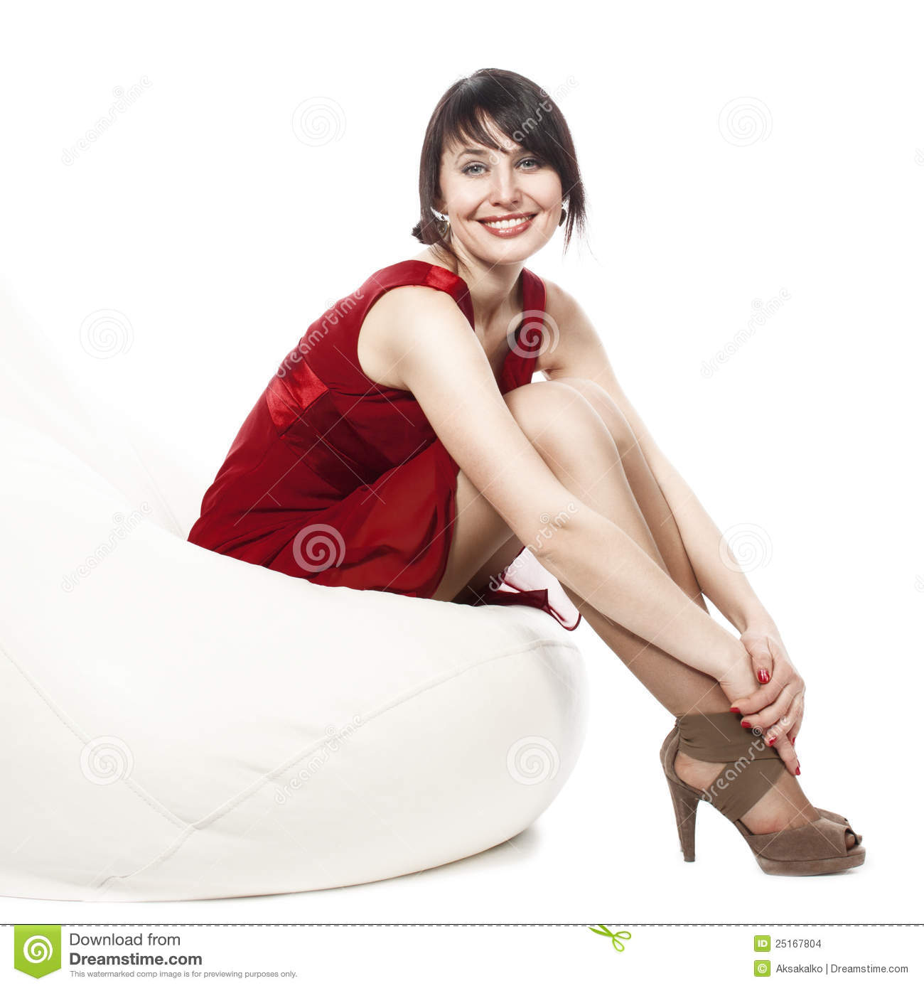 Woman in red dress sitting on armchair stock images for Sitting in armchair
