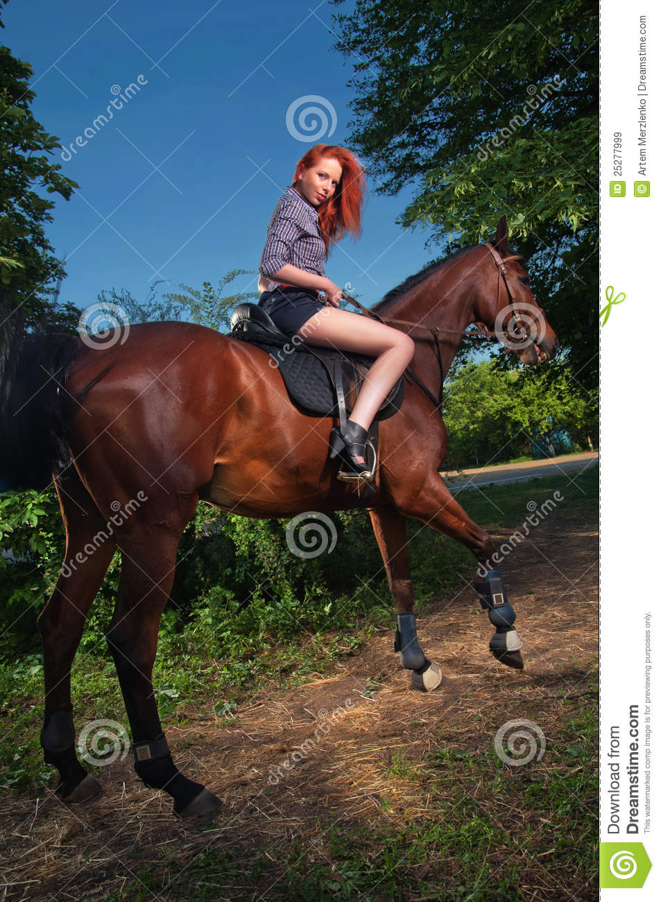 woman with red hair sitting on a horse royalty free stock