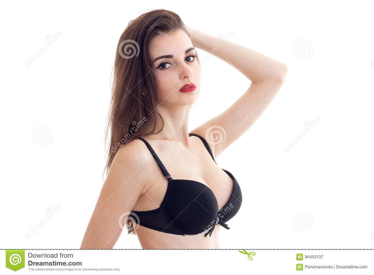 Young brunette woman with red lips with big natural boobs in black bra  looks at camera e4f426fa5