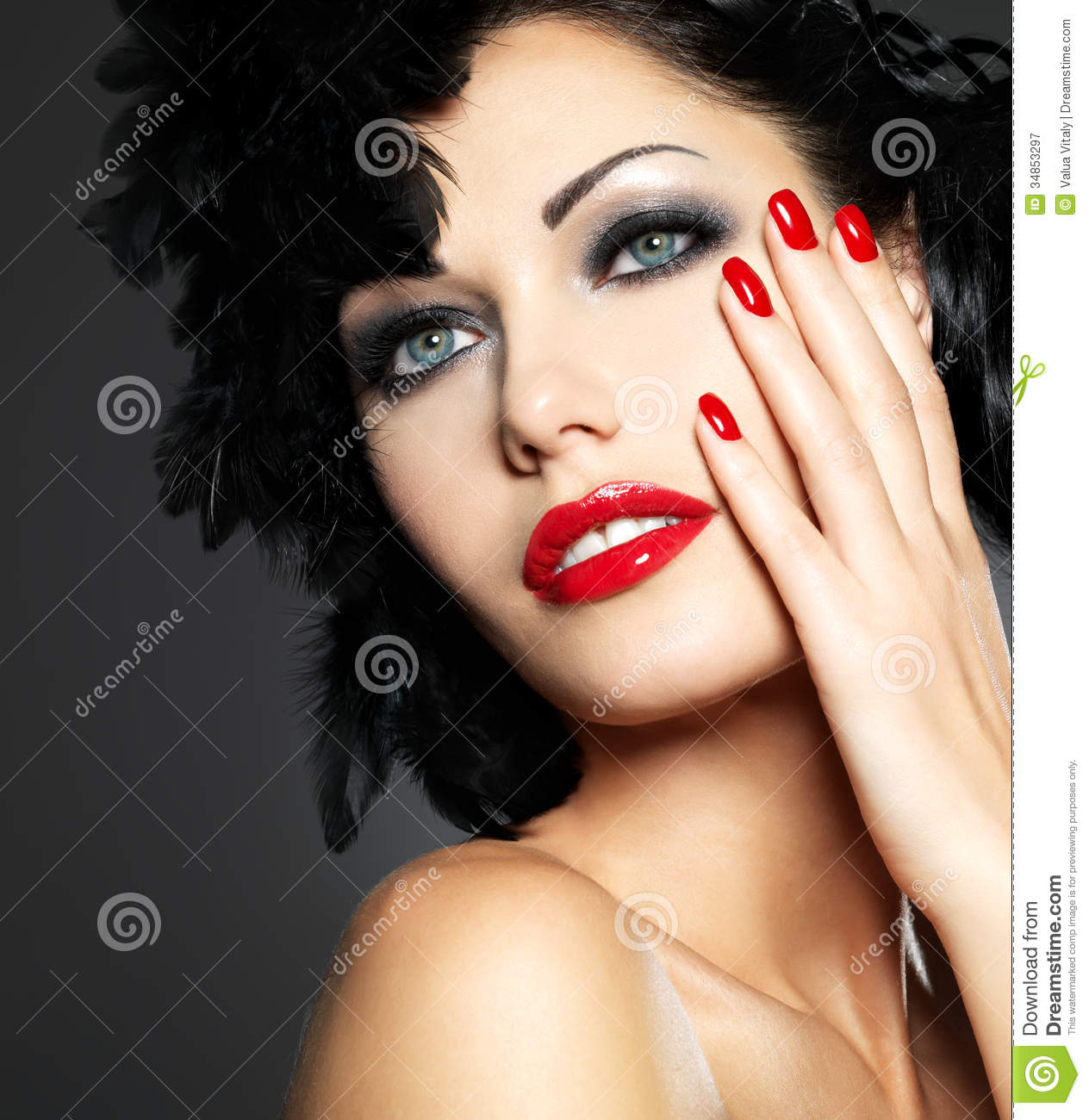 Woman With Red Nails And Creative Hairstyle Royalty Free
