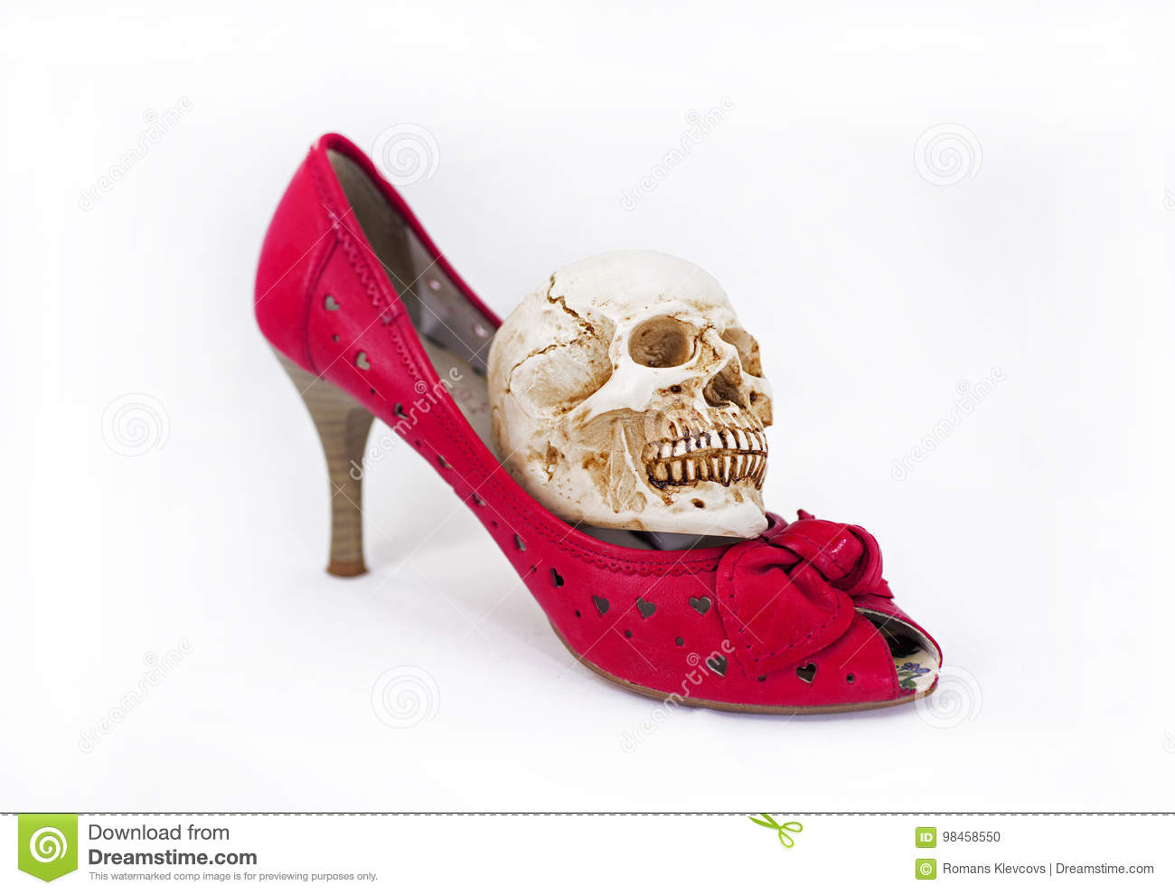 Woman red shoes and small skull.