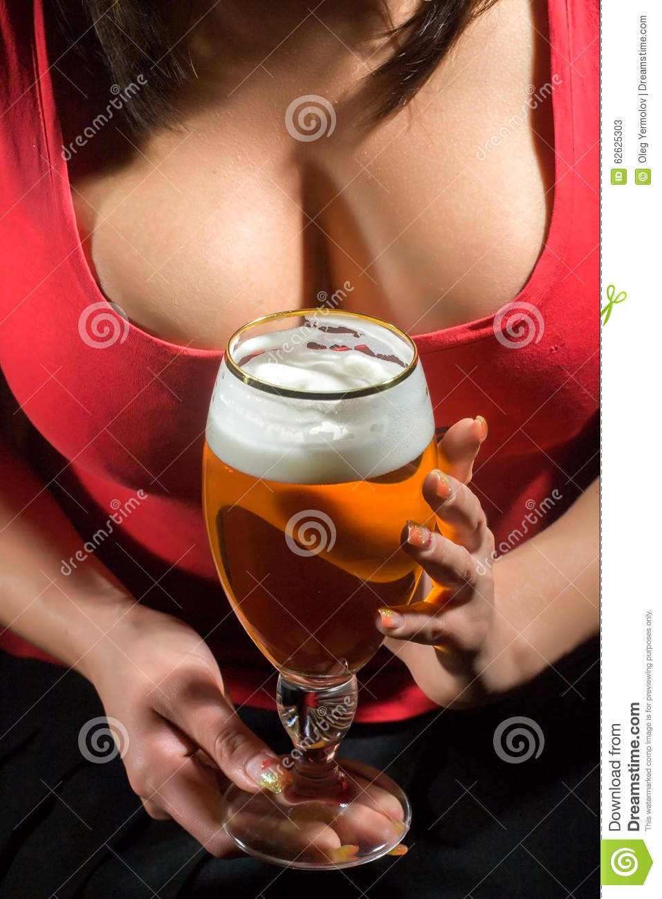 Woman in red t-shirt holding glass of beer