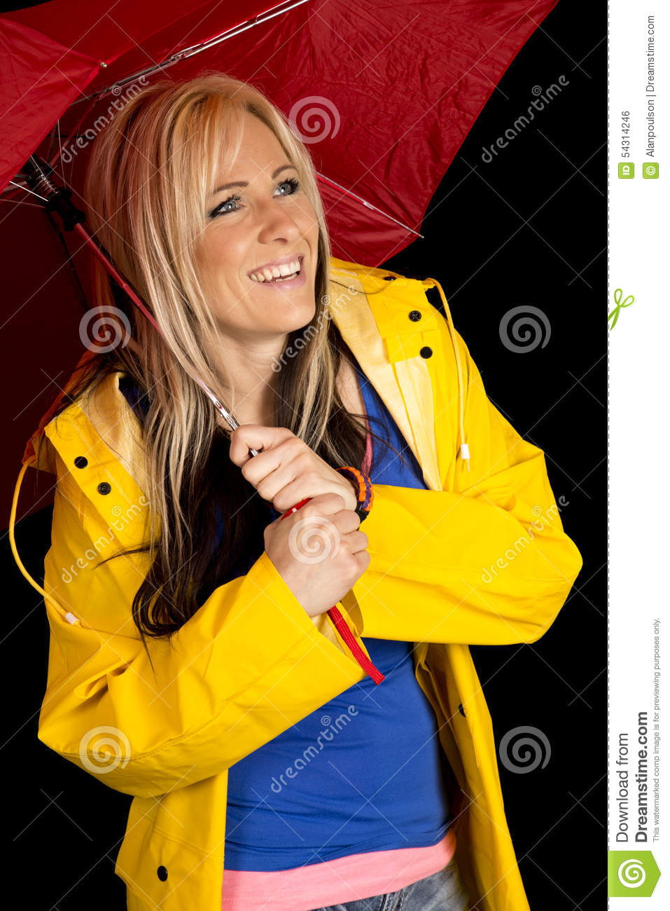 Woman red umbrella and yellow jacket happy