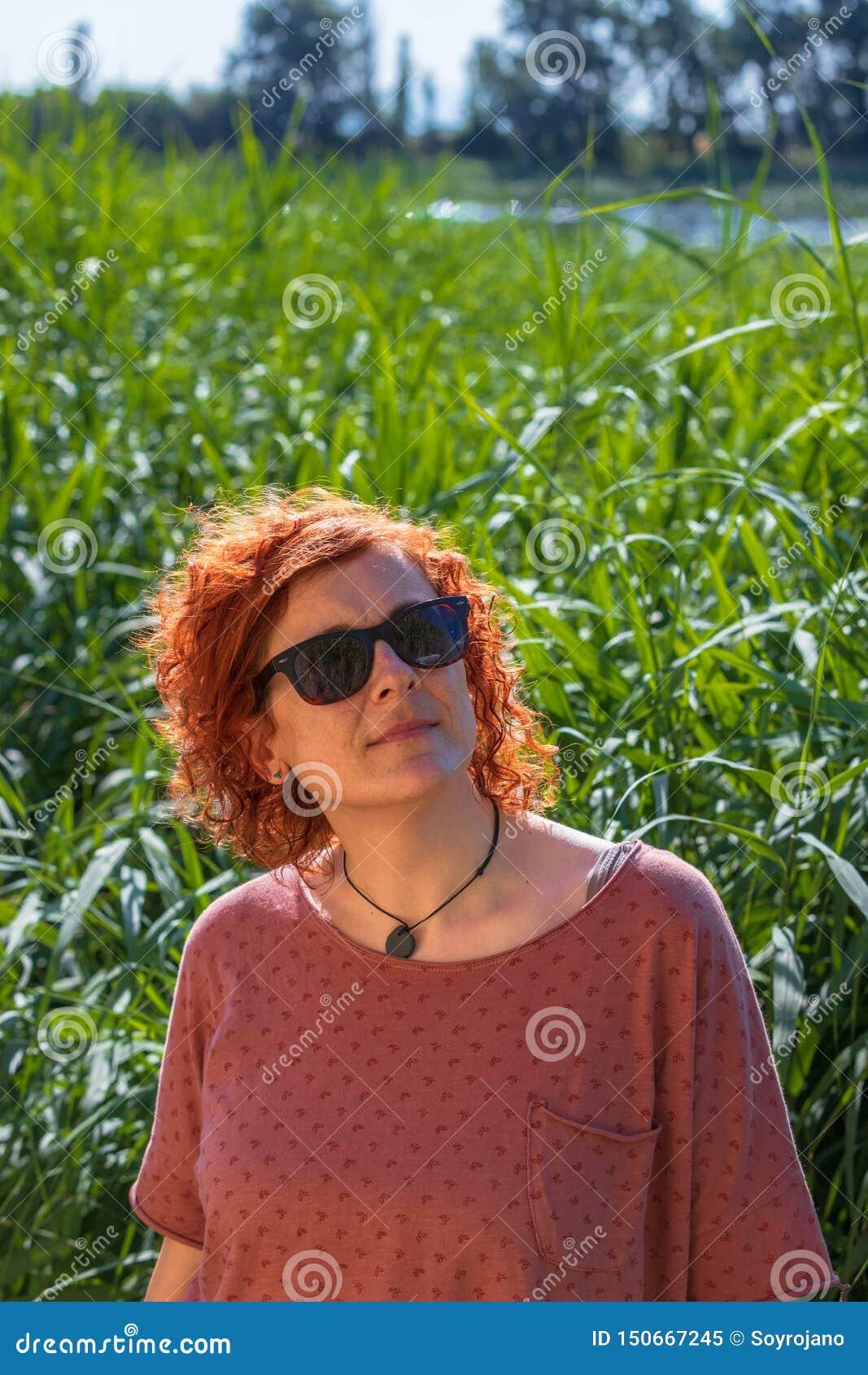 Woman redhead watching the sky