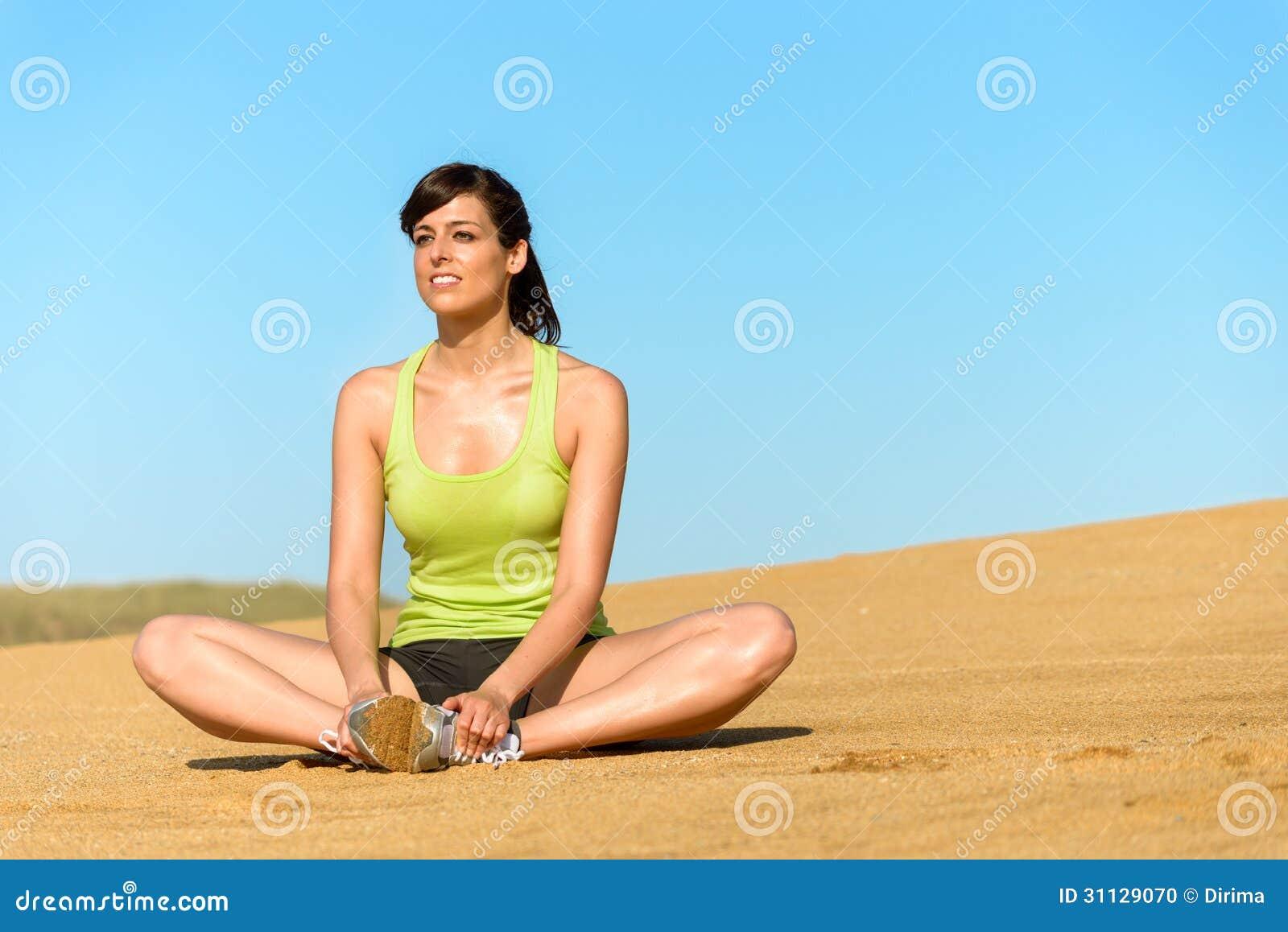 Happy woman relaxing on beach in summer beautiful brunette sporty