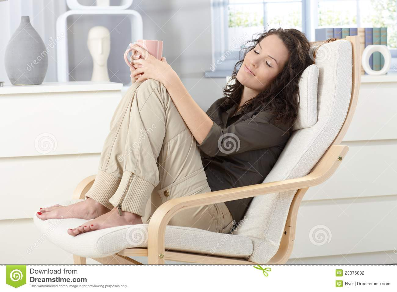 Woman relaxing in armchair stock photo. Image of armchair ...