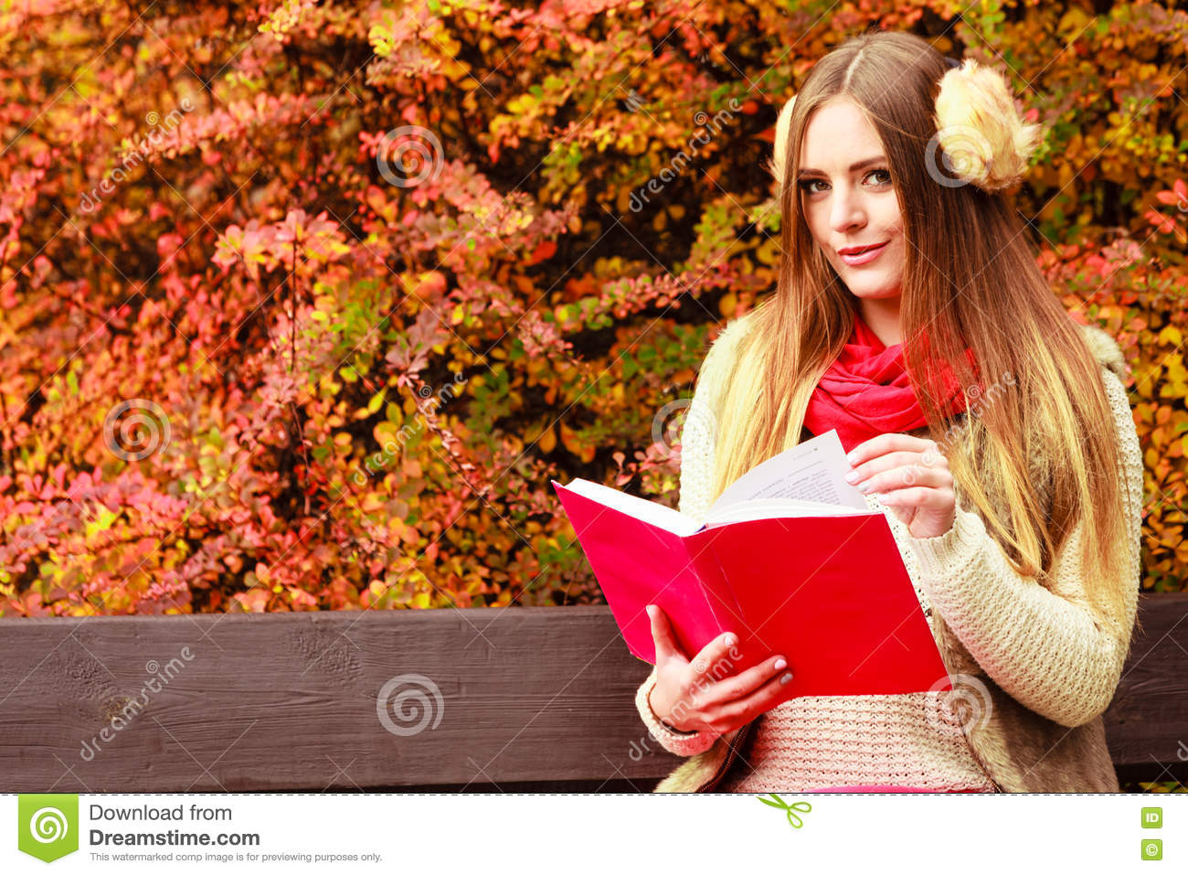 Woman Relaxing In Autumnal Park Reading Book Royalty Free Stock Image 76489564