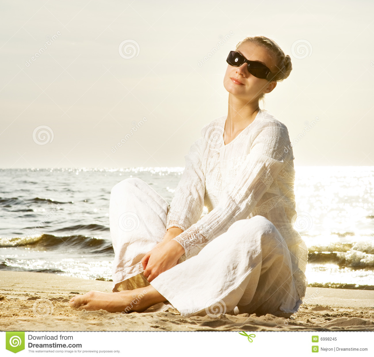 Woman Relaxing On A Beach Stock Image. Image Of Elegant