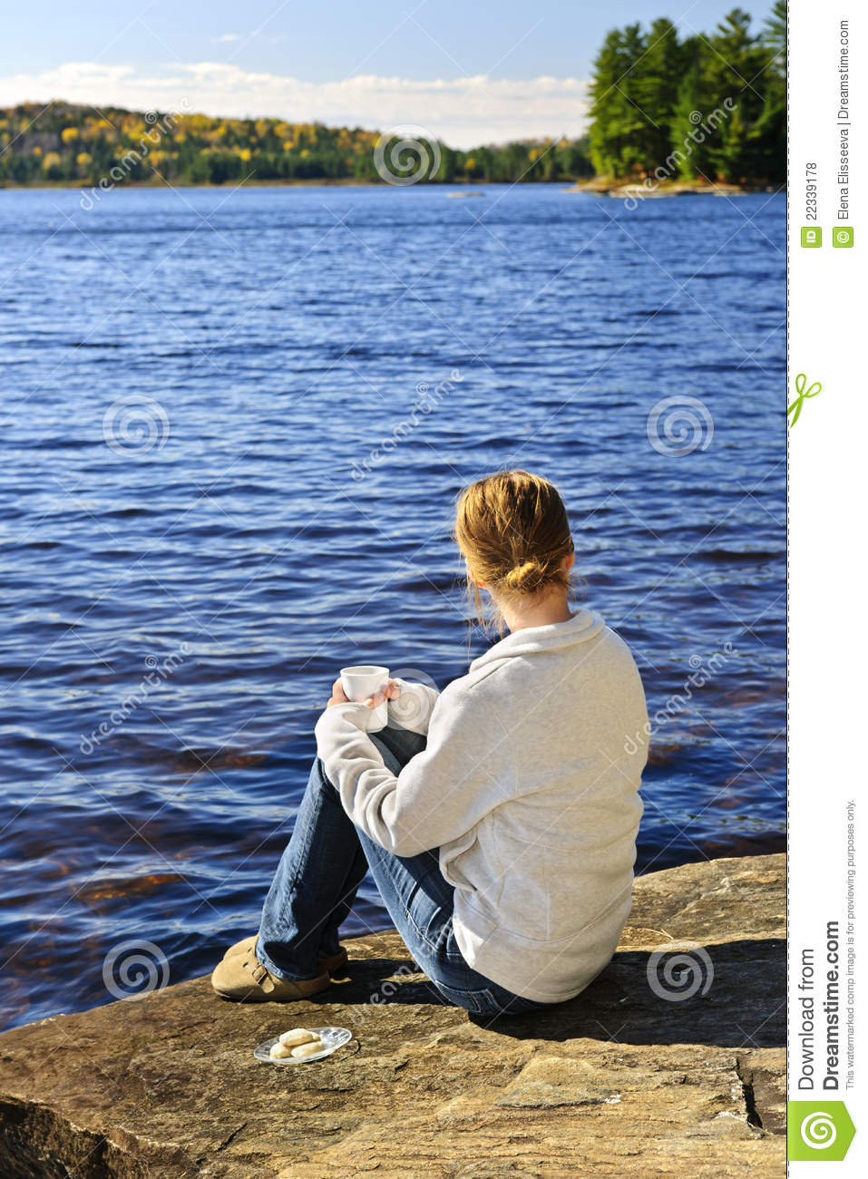 Woman Relaxing At Beautiful Lake Royalty Free Stock Photos