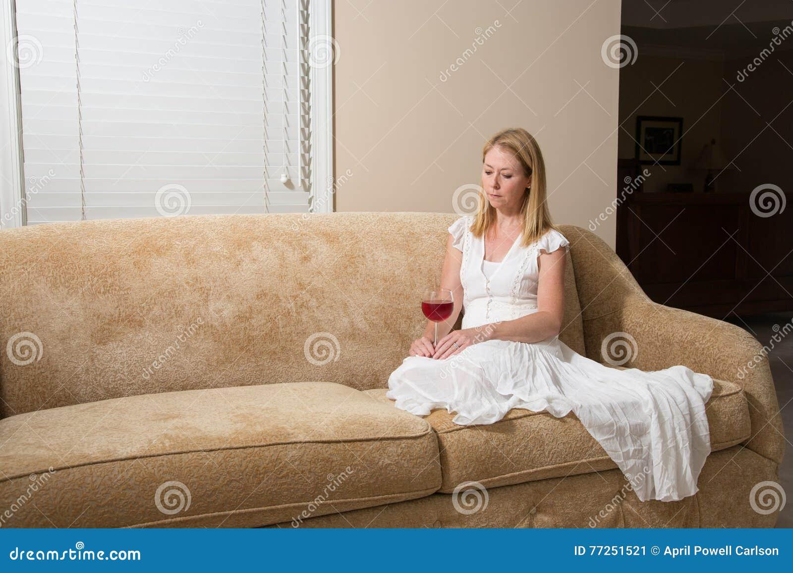 Awe Inspiring Woman Relaxing With Glass Of Wine At Home Stock Image Inzonedesignstudio Interior Chair Design Inzonedesignstudiocom
