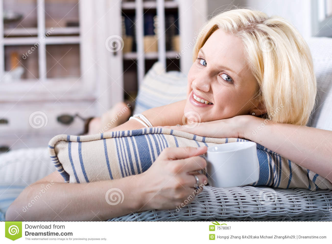 woman relaxing at home royalty free stock photography. Black Bedroom Furniture Sets. Home Design Ideas