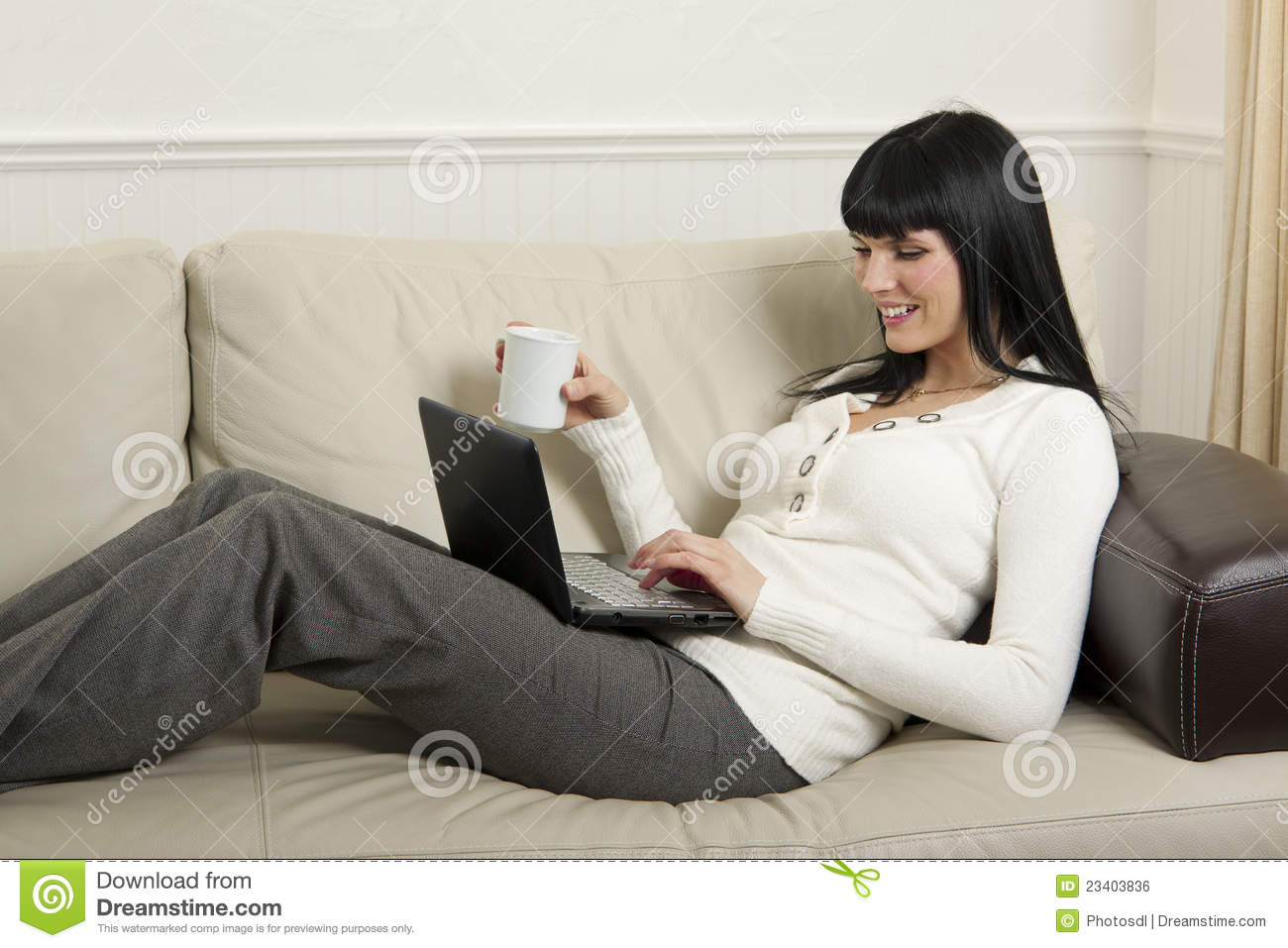 woman relaxing at home with her computer stock photo. Black Bedroom Furniture Sets. Home Design Ideas