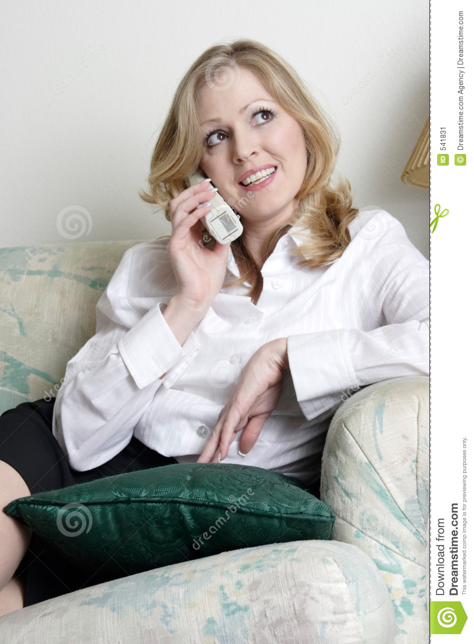 Woman Relaxing At Home Talking On The Phone Stock Image