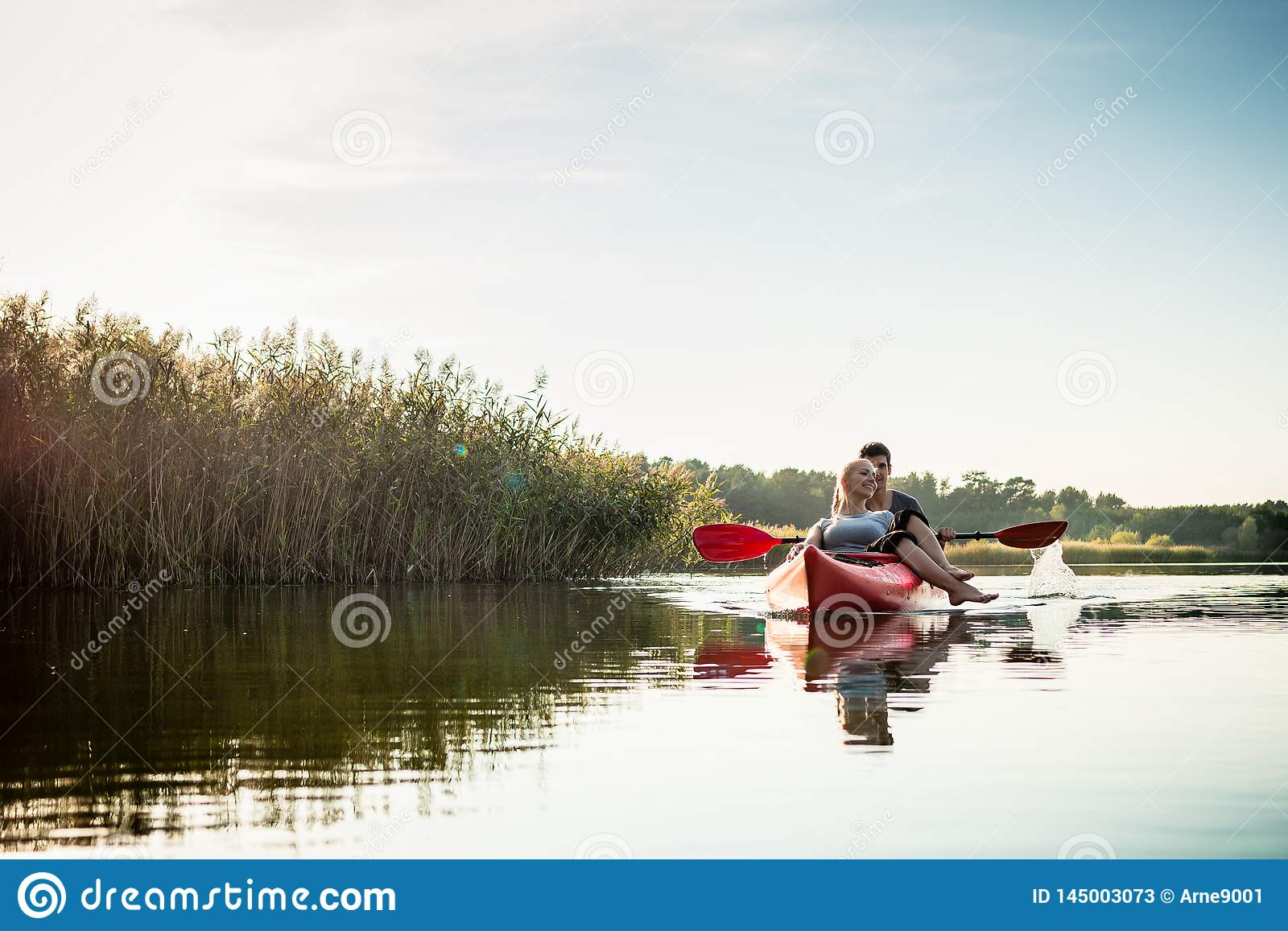Woman relaxing in kayak with her boyfriend