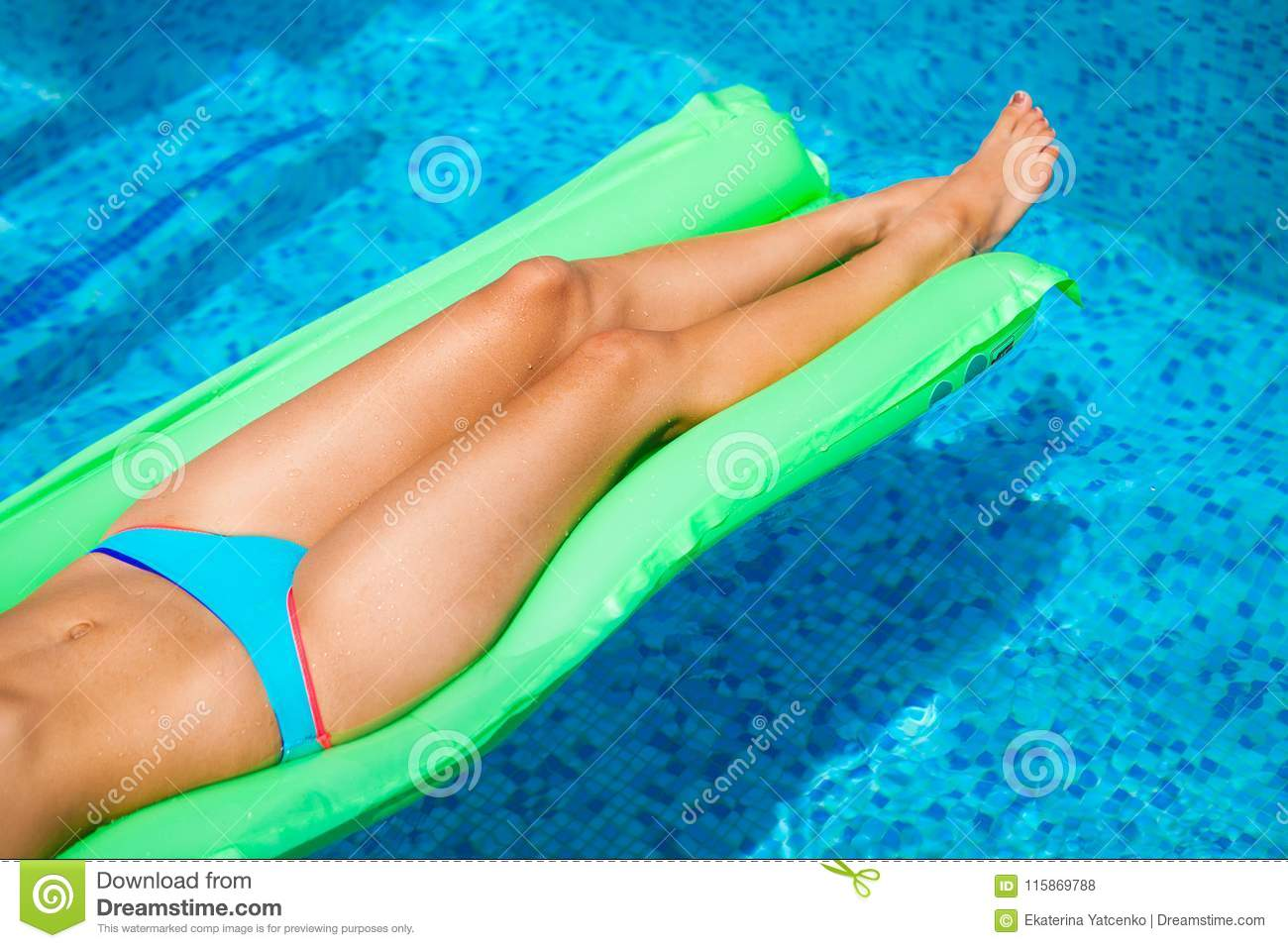 Woman relaxing on mattress in the pool water in hot sunny day. S
