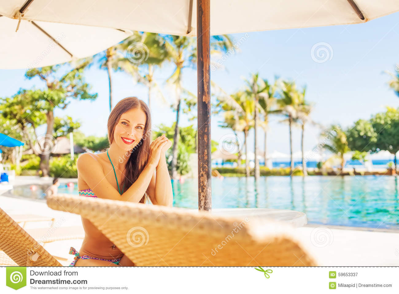 Woman relaxing near a swimming pool stock photo image - Get a swimming pool full of liquor ...