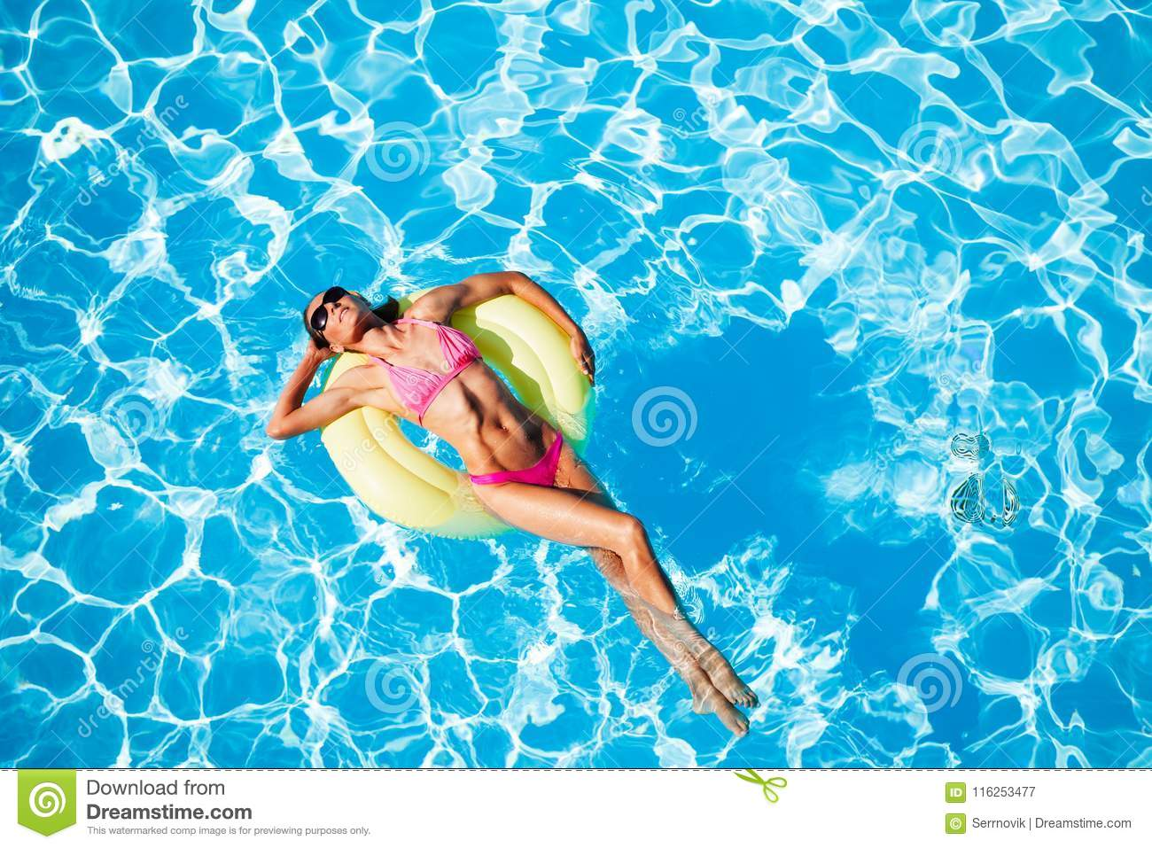 Woman Relaxing On Rubber Ring In The Swimming Pool Stock ...