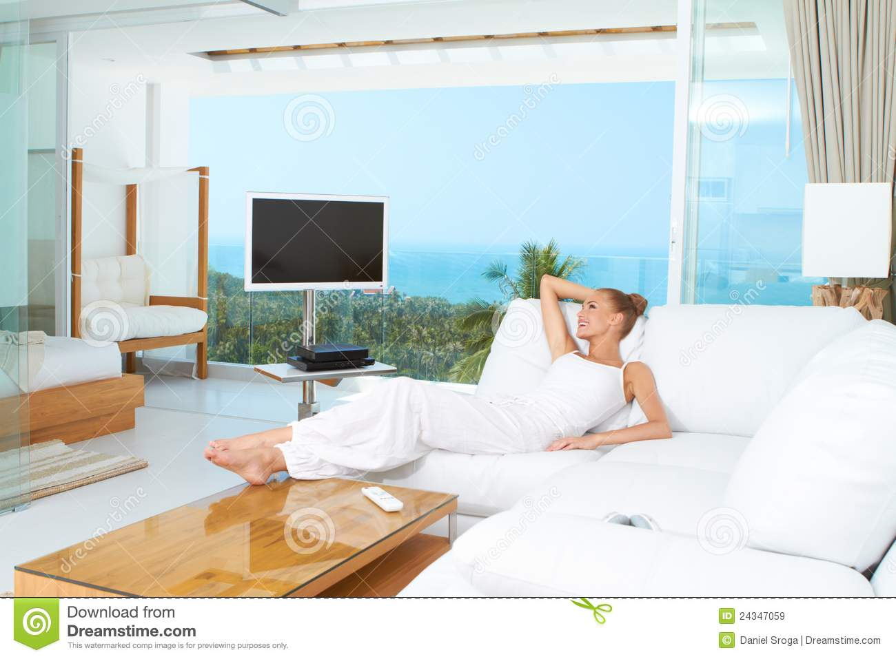 Relaxing Living Room Woman Relaxing In Spacious Bright Living Room Royalty Free Stock