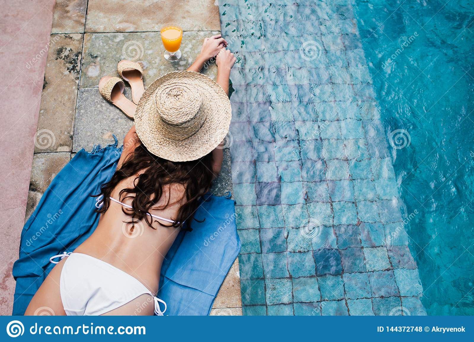 Woman relaxing in swimming pool.
